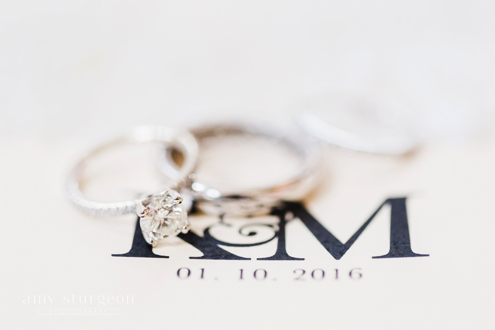 Solitaire diamond ring with monogrammed invitations at the alpaca farm wedding in ottawa