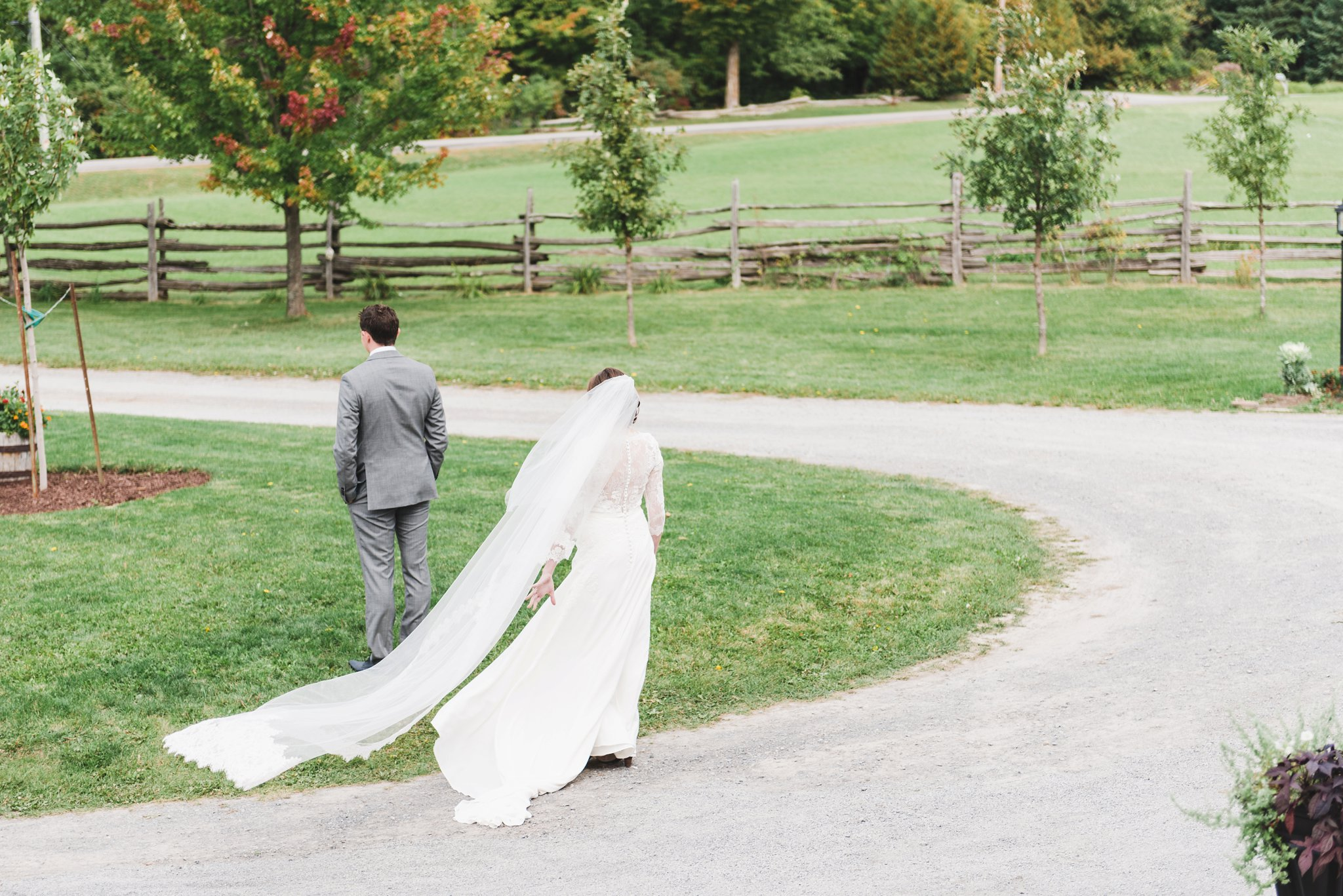 her veil was longer than her dress and blew in the wind at the alpaca farm wedding in ottawa