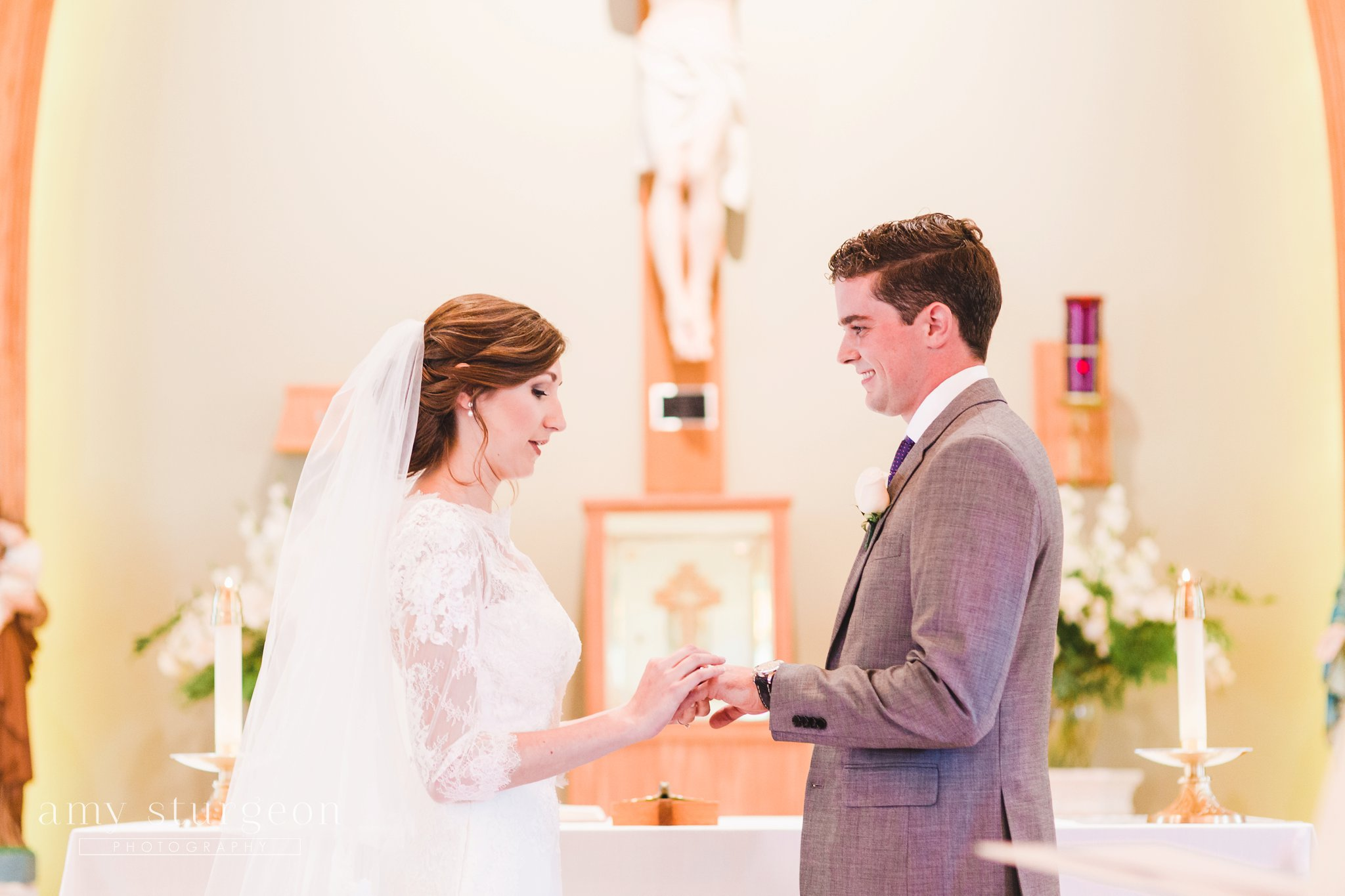 Exchanging of rings at the alpaca farm wedding