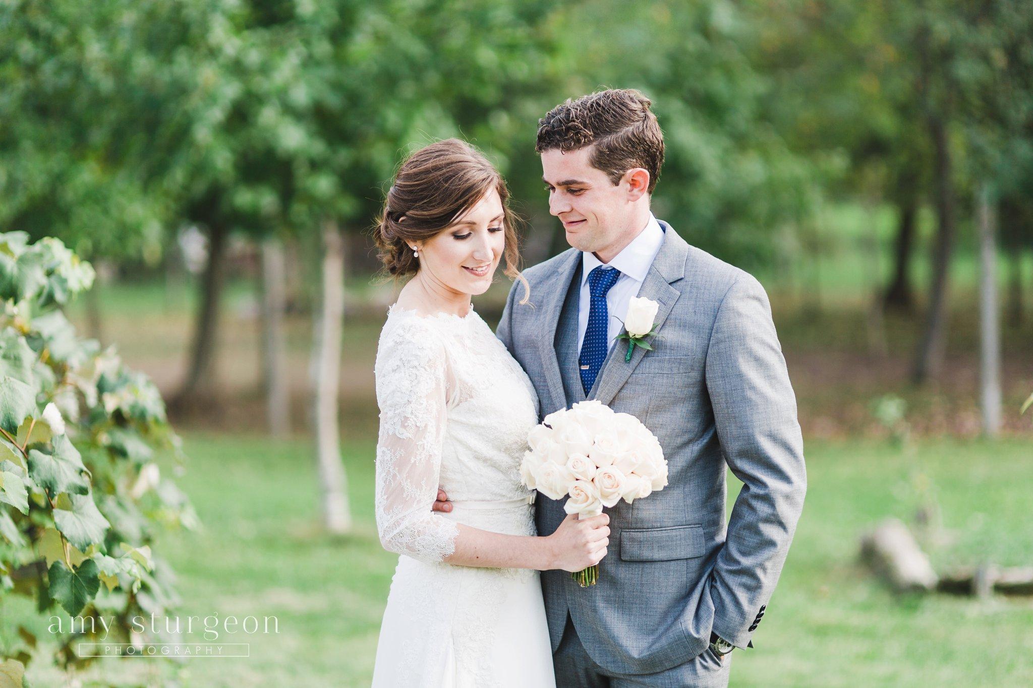 Her elegant white rose bouquet at the alpaca farm wedding