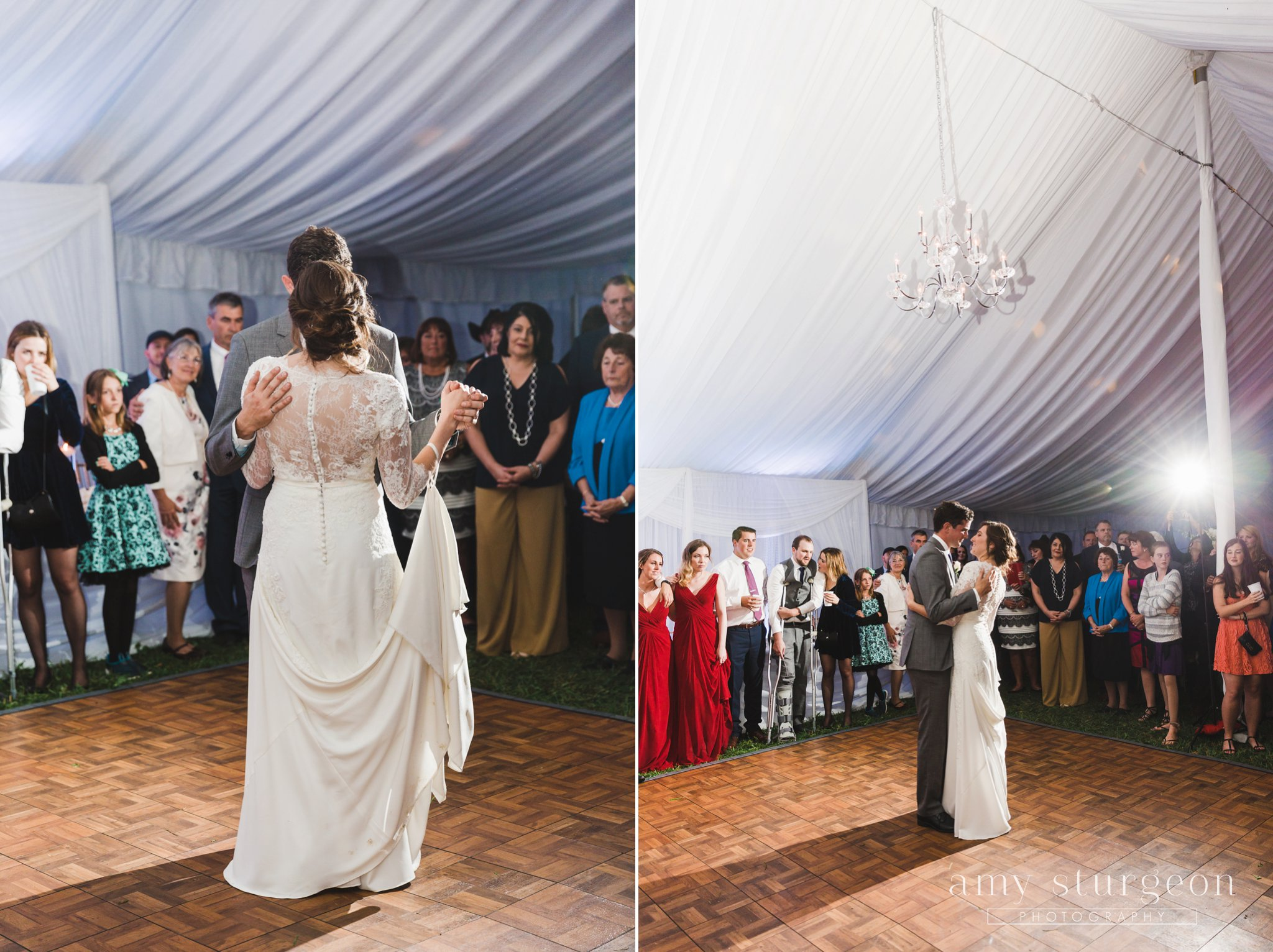 The bride and groom embrace for their first dance while surrounded by friends and family at the alpaca farm wedding