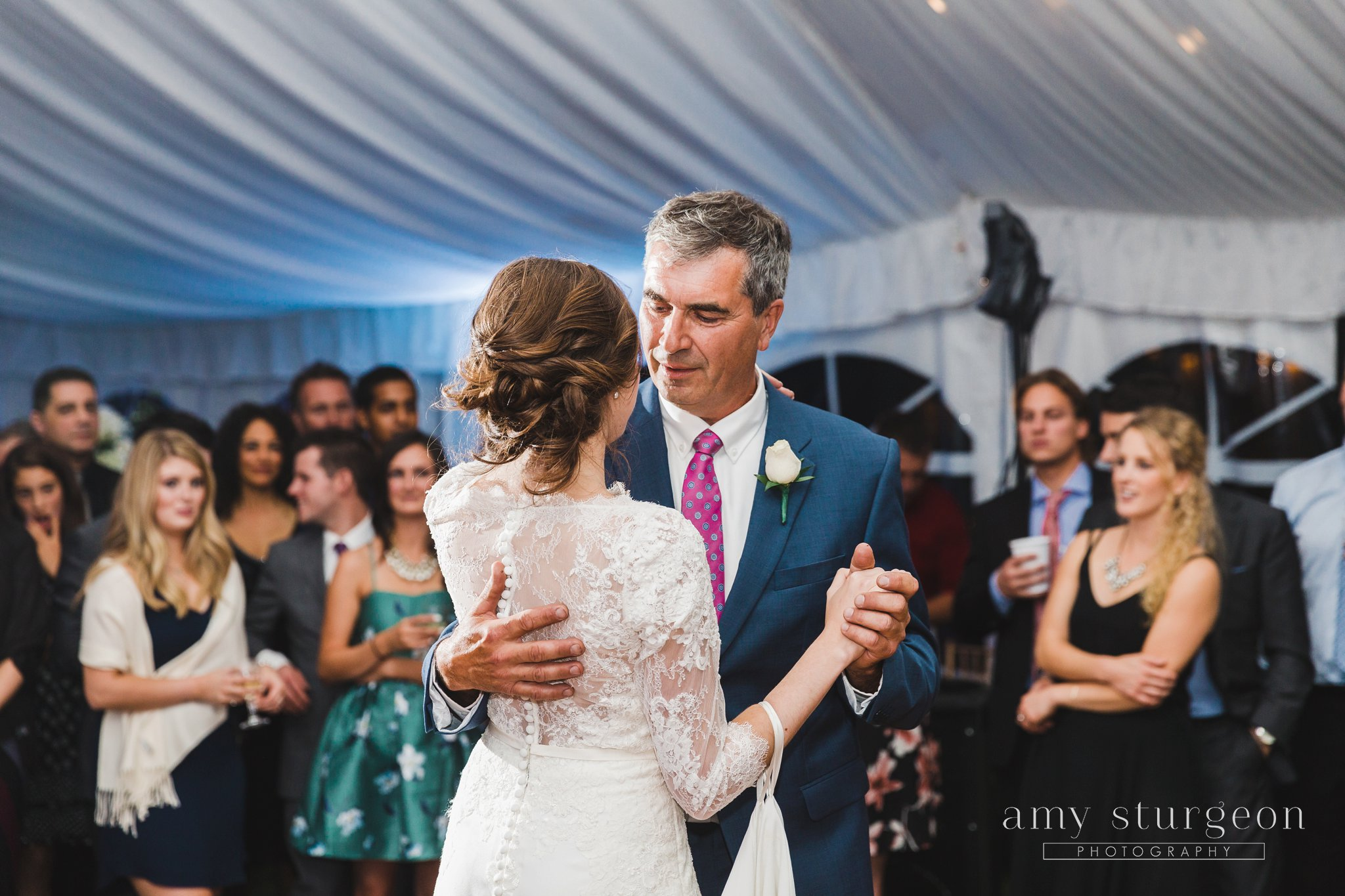 Everyone watched as the bride and her father had their first parent dance at the alpaca farm wedding