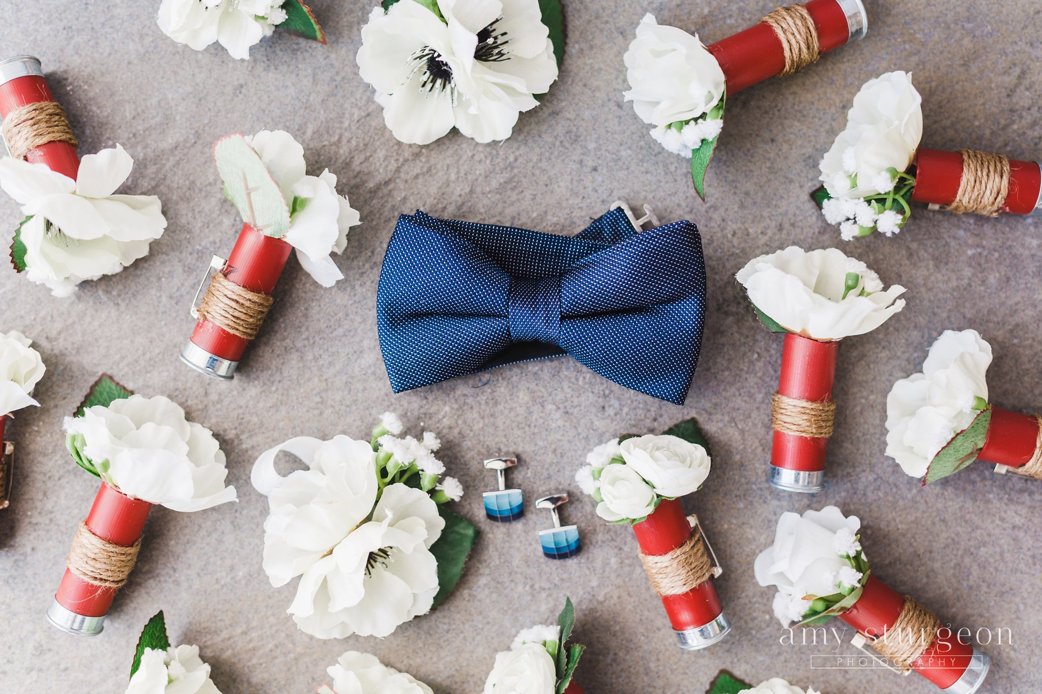 Homemade shell casing boutonnieres at the Canadian Aviation Museum Wedding