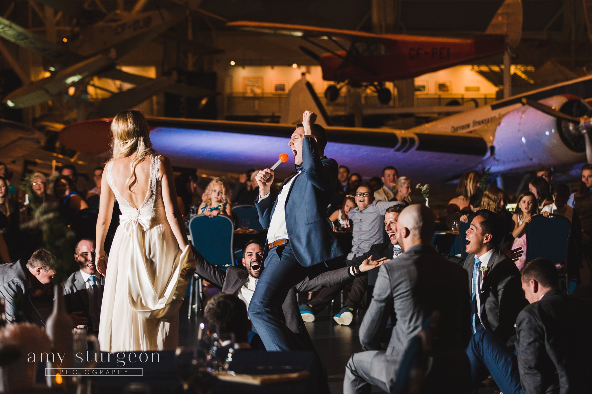 Surprise dance for the bride at the Canadian aviation museum wedding