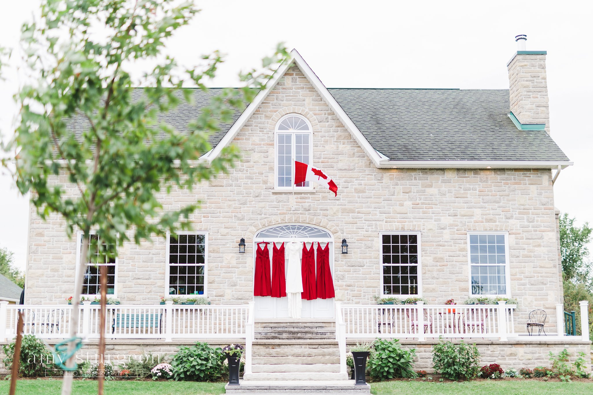 The crimson bridesmaid dresses matched the red in the Canada flag at the alpaca farm wedding in ottawa