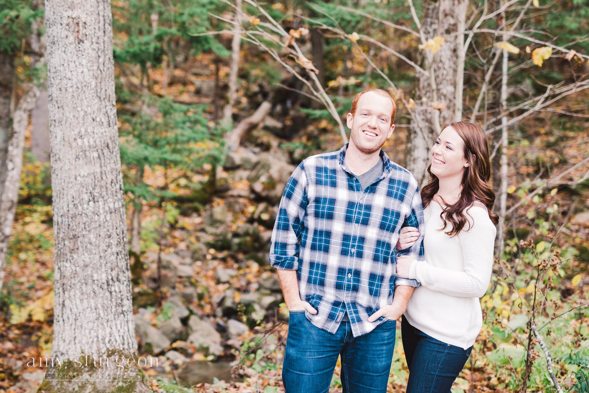 Candid groom pose at the Fall Wakefield Engagement Session by the covered bridge
