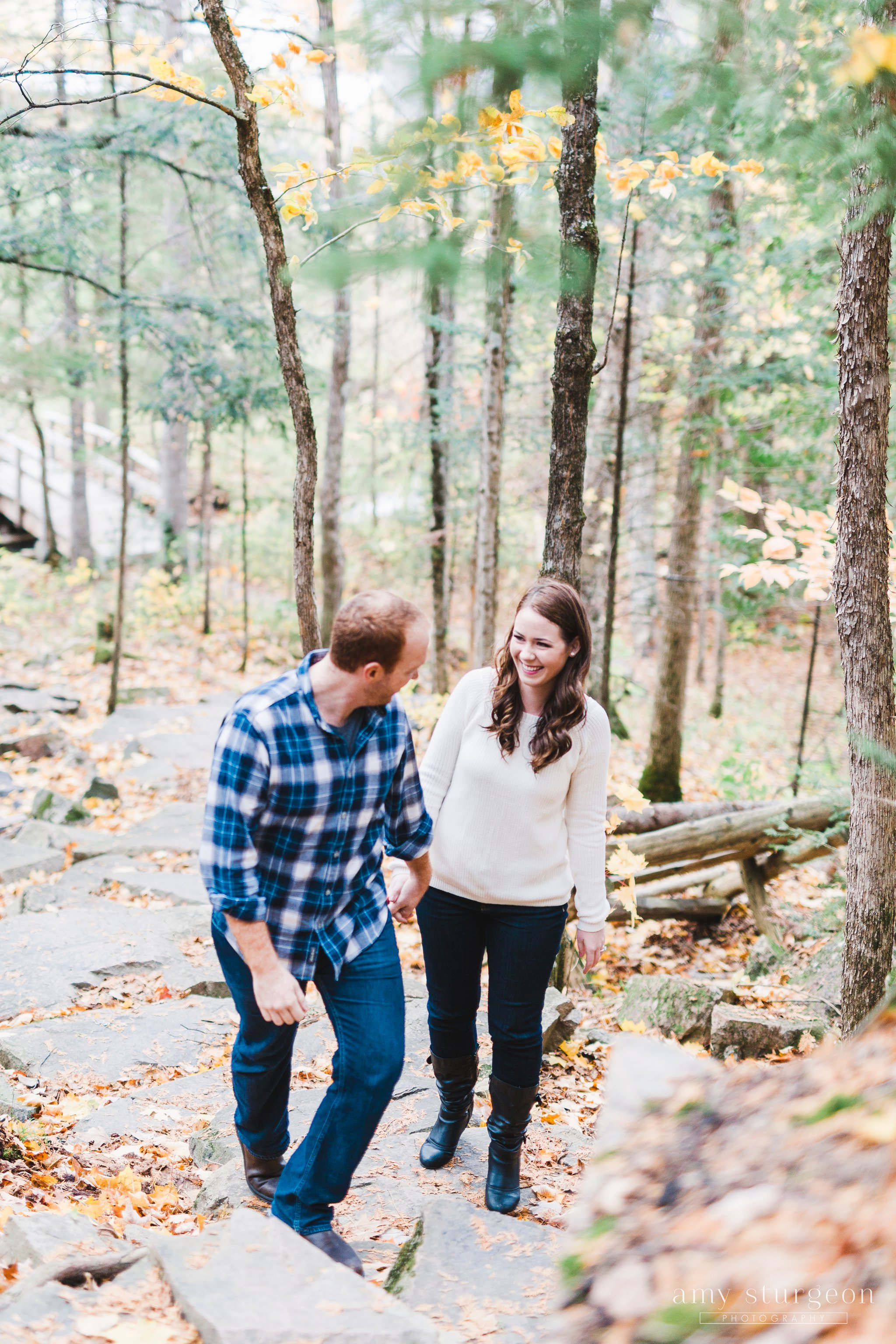 Walking up the stone path for their Fall Wakefield Engagement Session by the covered bridge