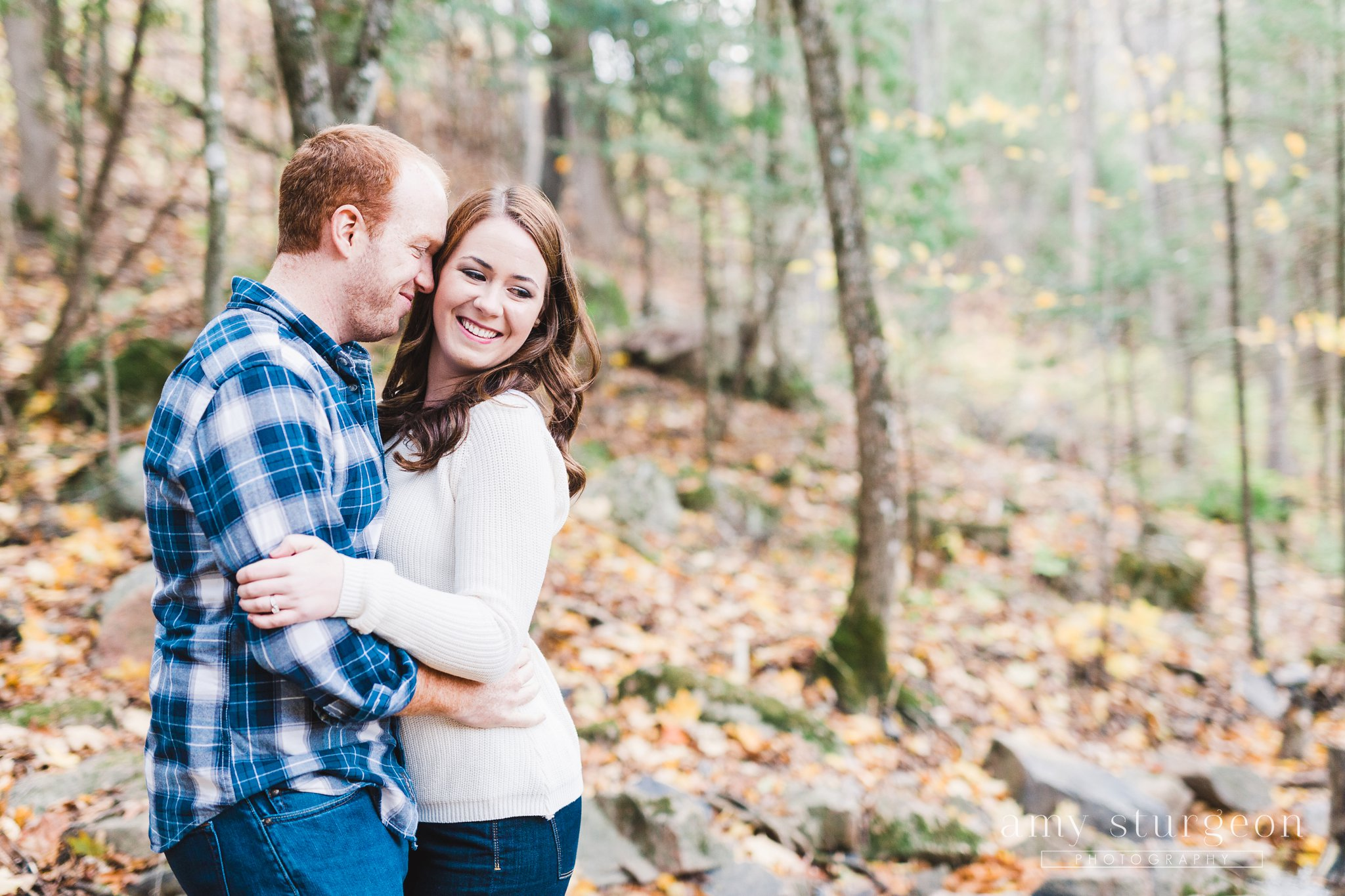 Cozy clothing for their Fall Wakefield Engagement Session by the covered bridge
