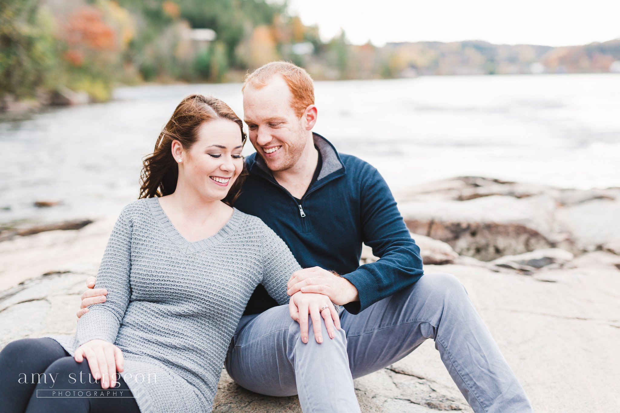 Sitting pose for the Fall Wakefield Engagement Session by the covered bridge