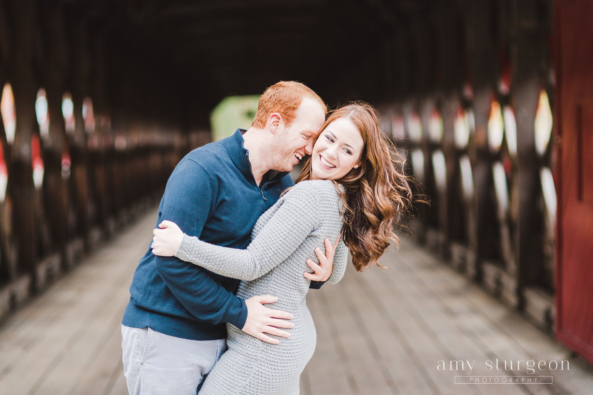 Dip kiss at the Fall Wakefield Engagement Session by the covered bridge
