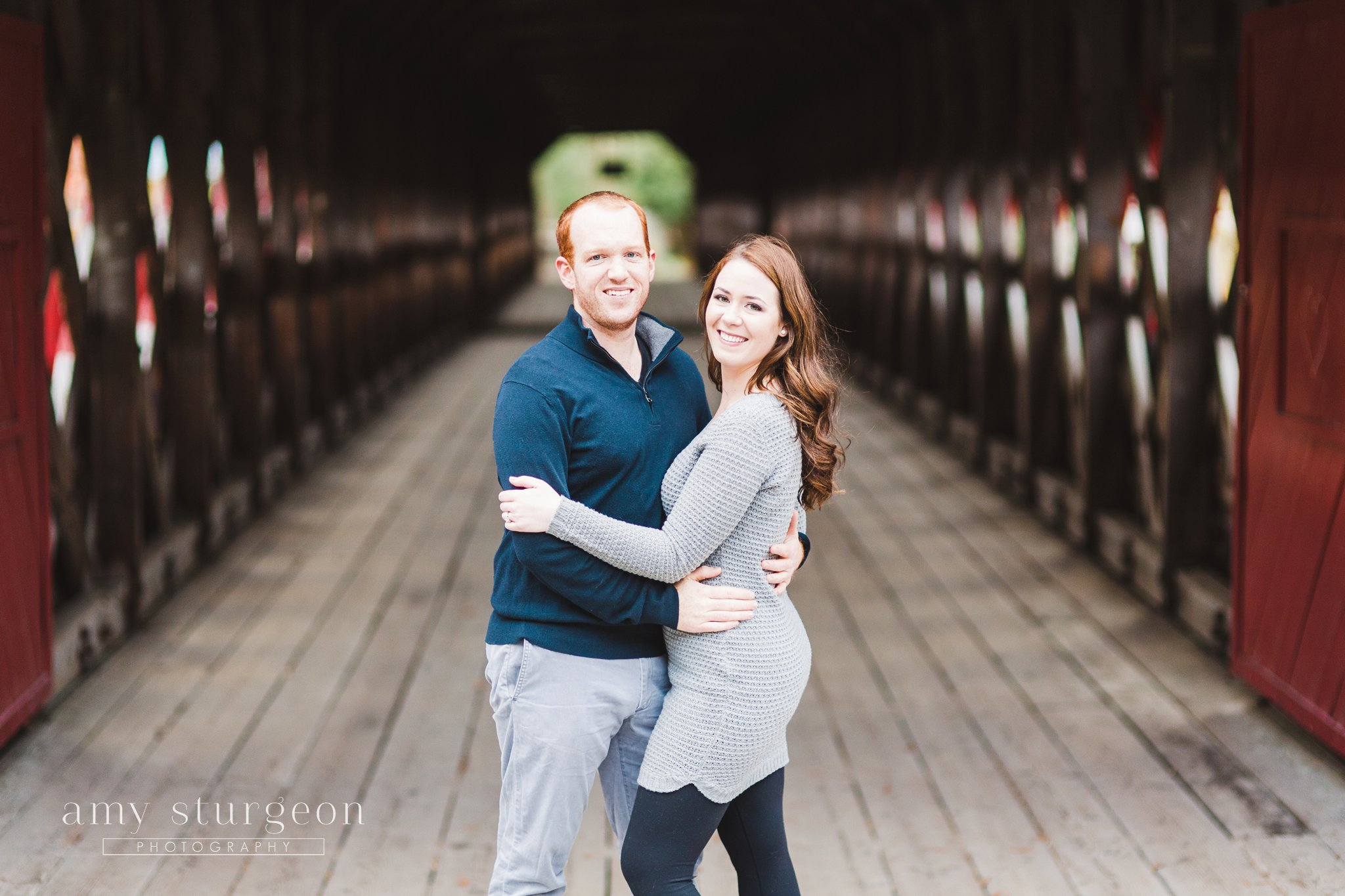 The bride and groom at the covered bridge for their Fall Wakefield Engagement Session