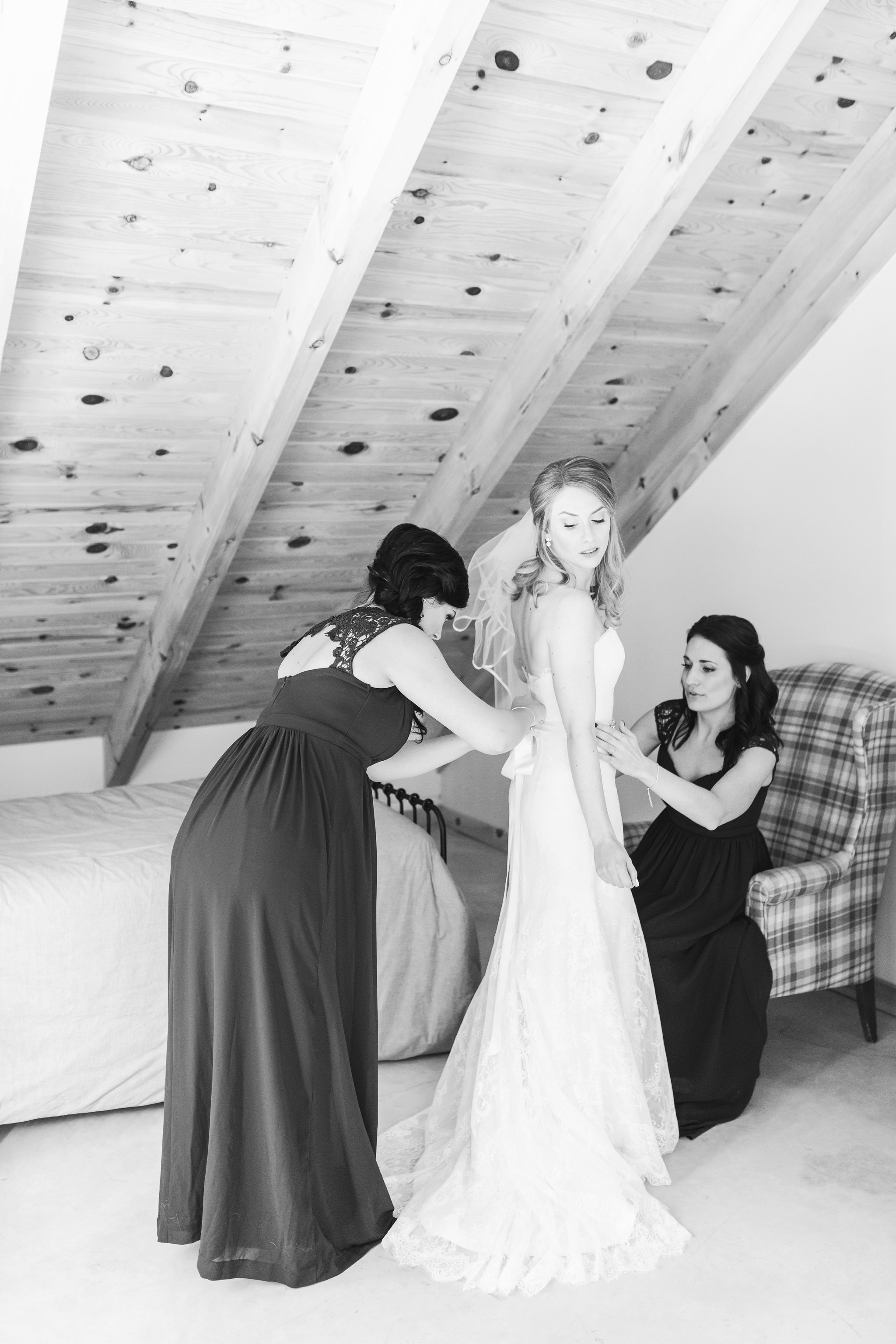 Bride gets dresses in the bridal suite at the Winter wedding at Le Belvedere