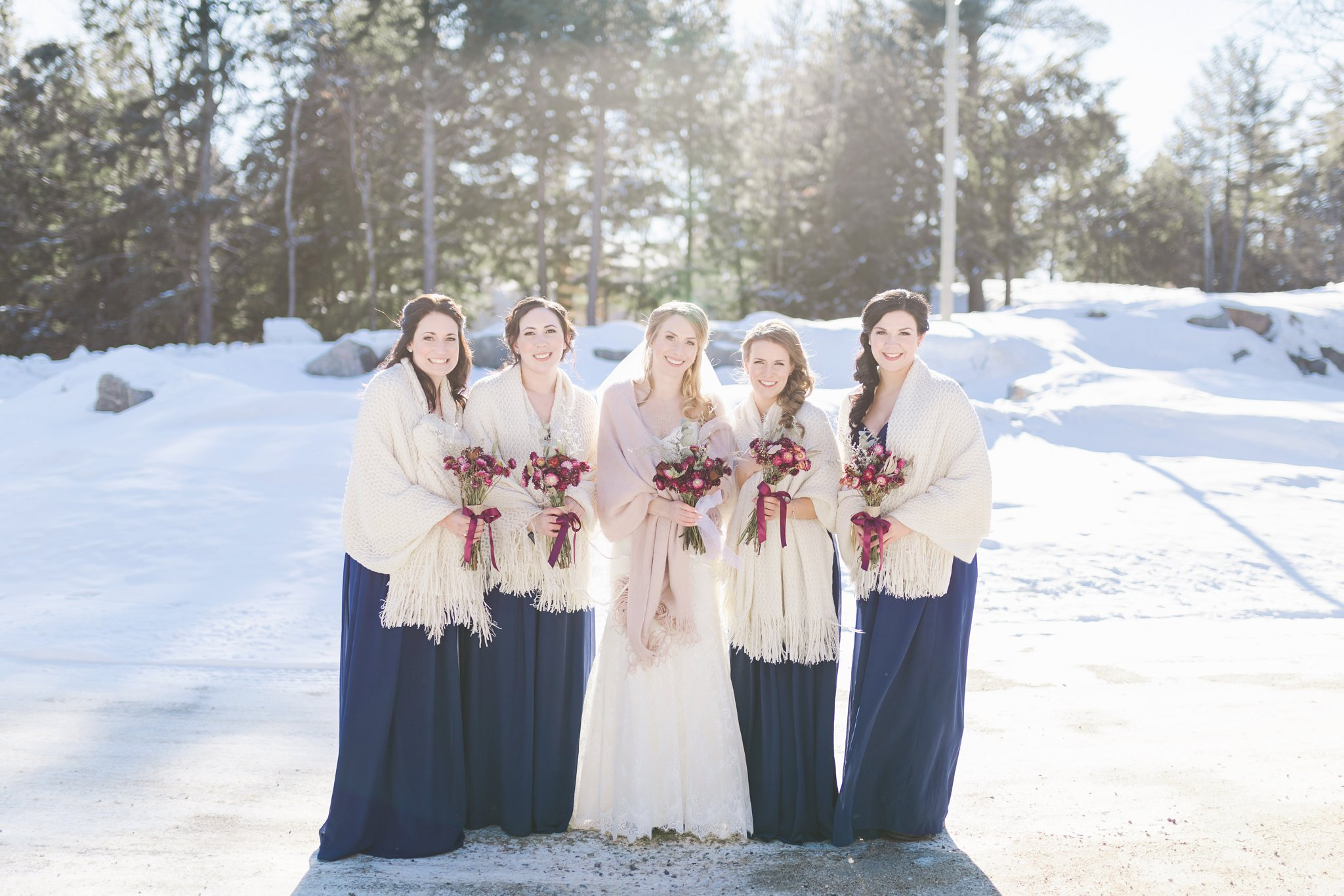 Bridal party in the snow at the Winter wedding at Le Belvedere