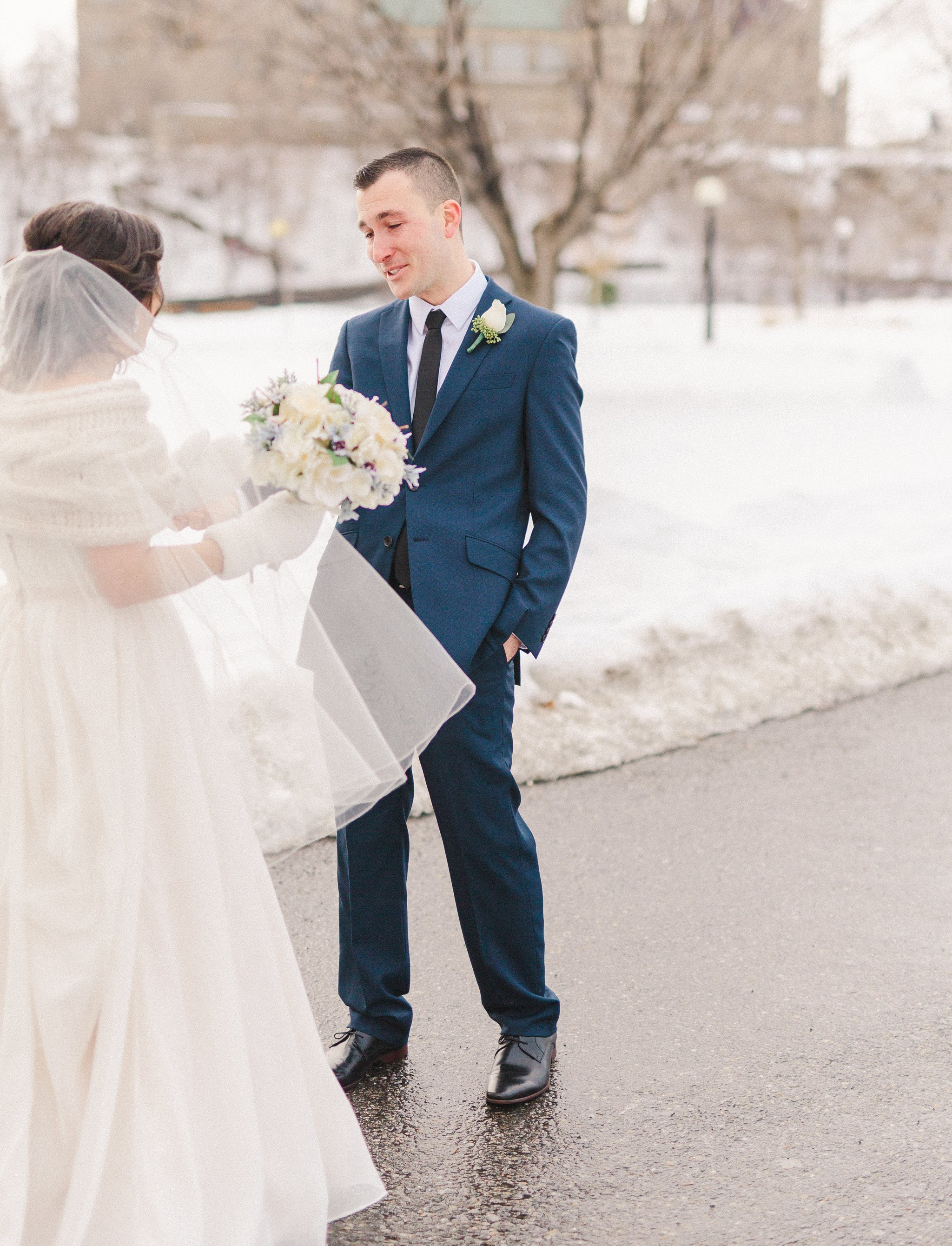 The first look outside the chateau laurier A Winter wedding at the Mill street Brew Pub wedding in Ottawa, Amy Pinder Photography