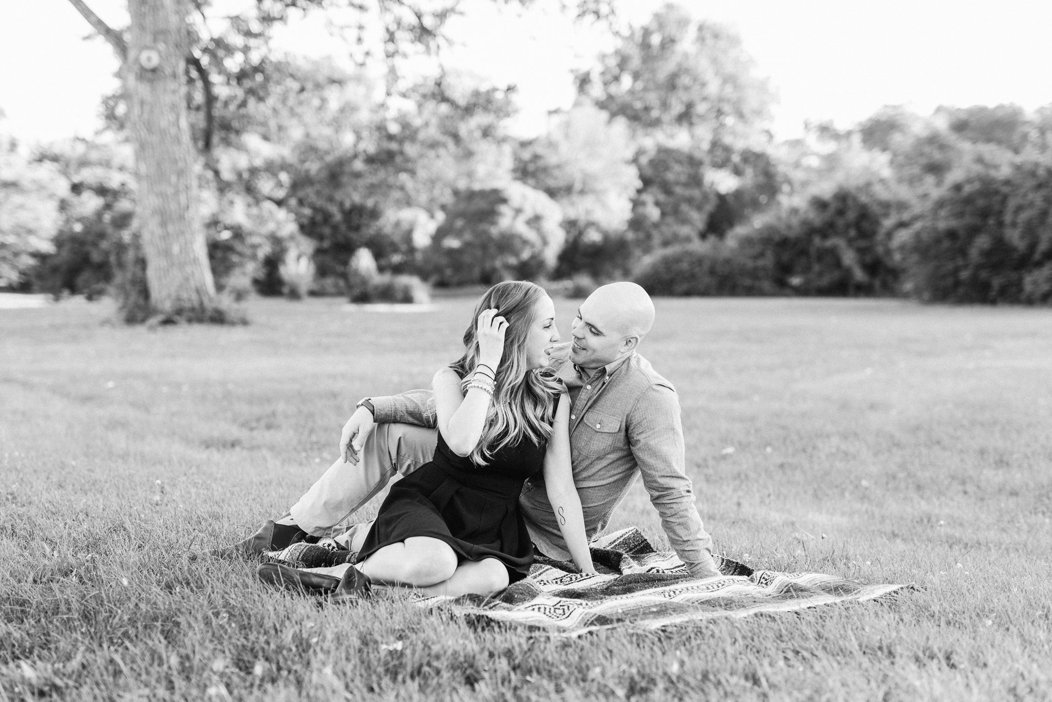 Picnic blanket, Engagement photos at Dominion Arboretum with a small dog, little black dress engagement session, pink collared shirt, Amy Pinder Photography, Ottawa wedding photographer, light and airy wedding photographer