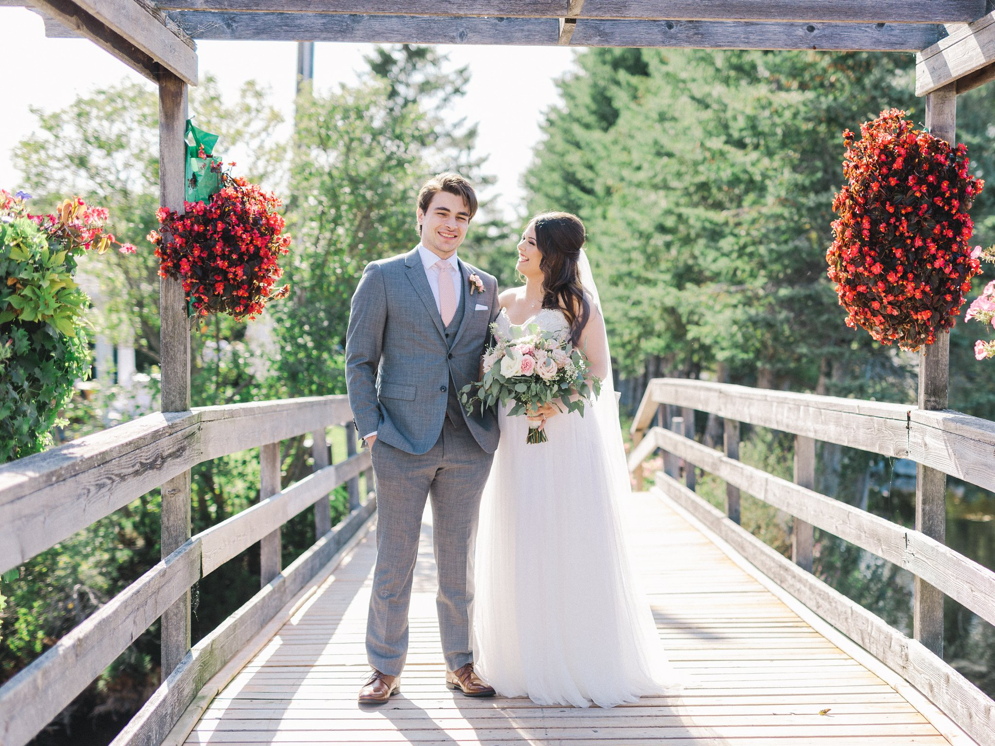 Light grey Indochino suit in Orchardview wedding photos