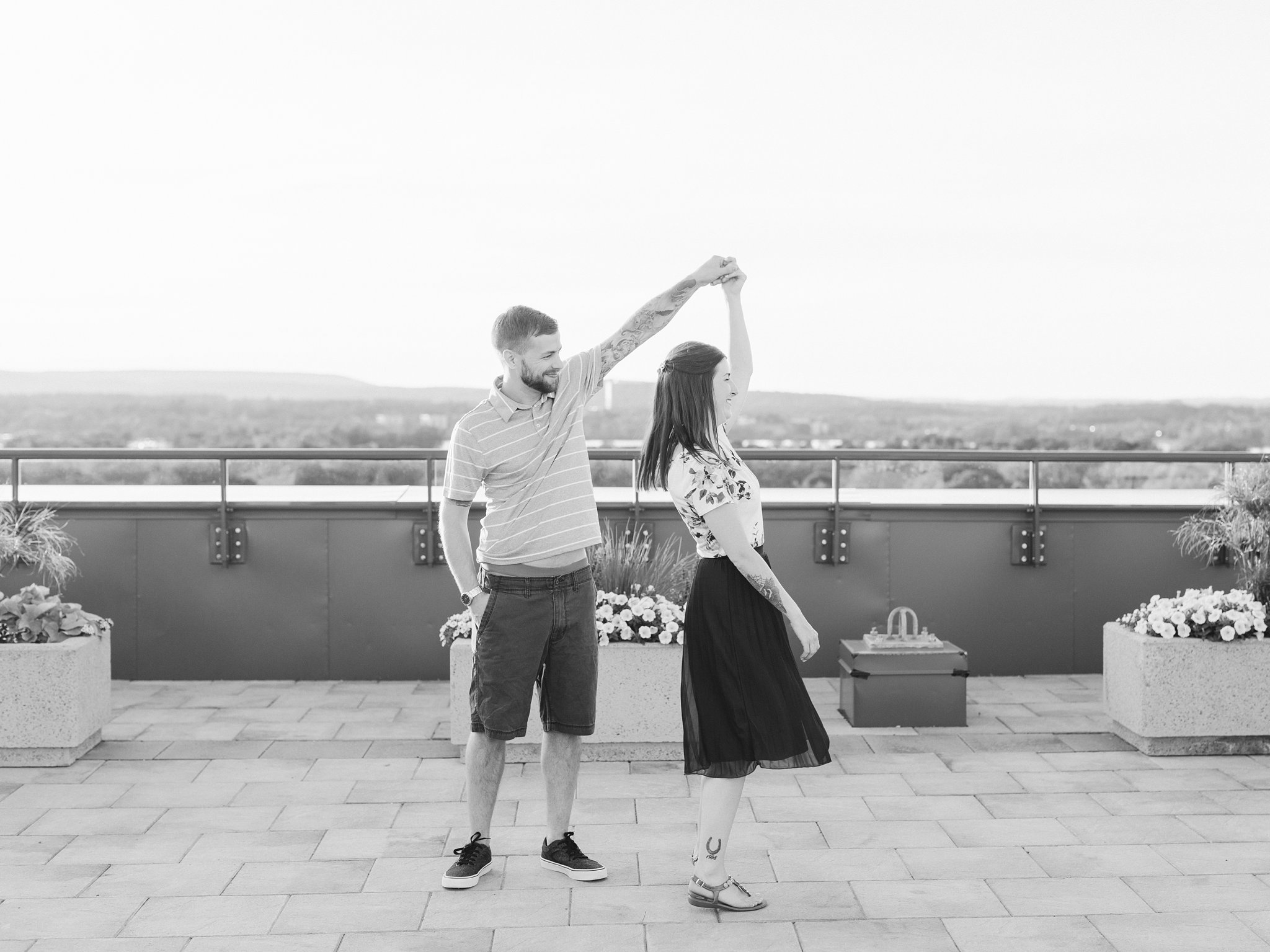 Dancing at sunset terrace condo engagement photos Hintonburg Ottawa