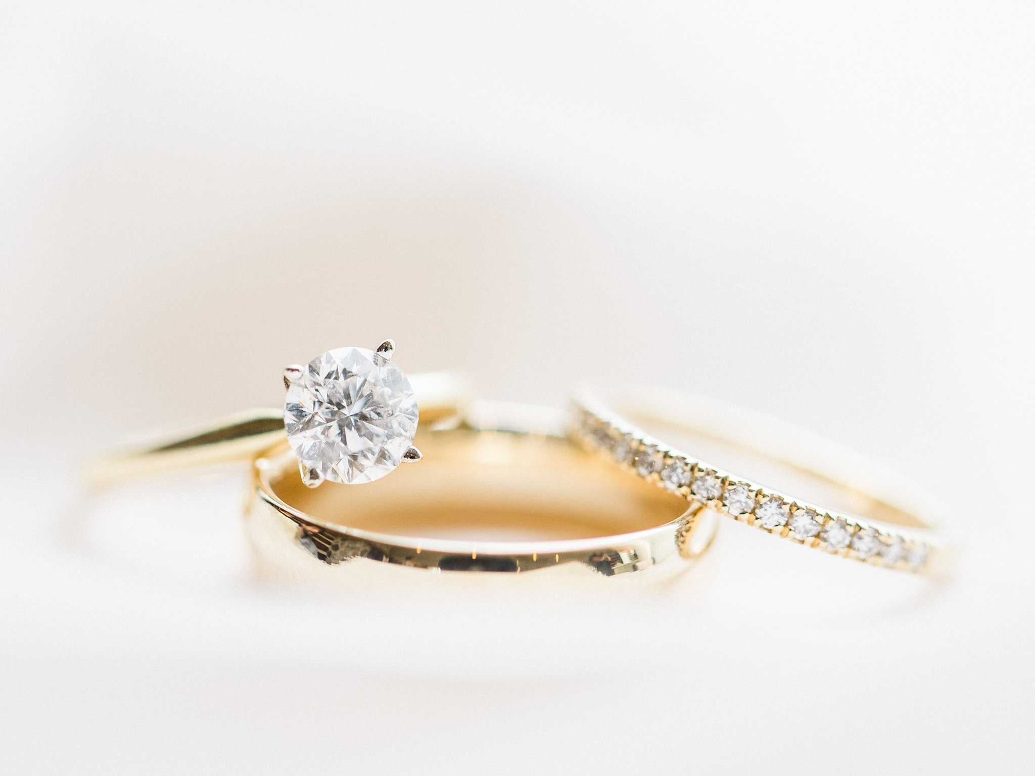 Diamond engagement ring yellow gold band married at Stonefields, Amy Pinder Photography