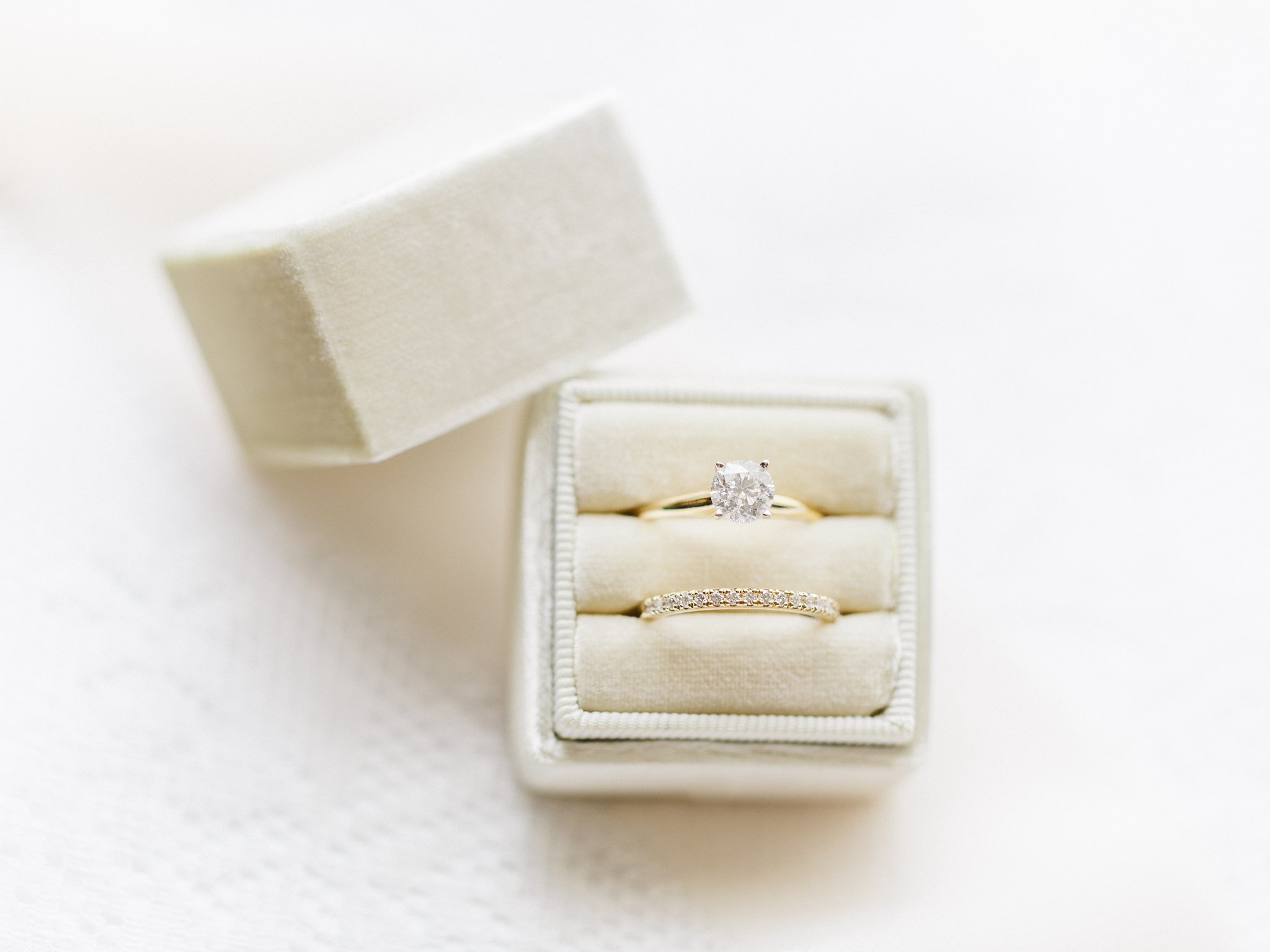 Beige Mrs. Box with gold Diamond rings married at Stonefields, Amy Pinder Photography