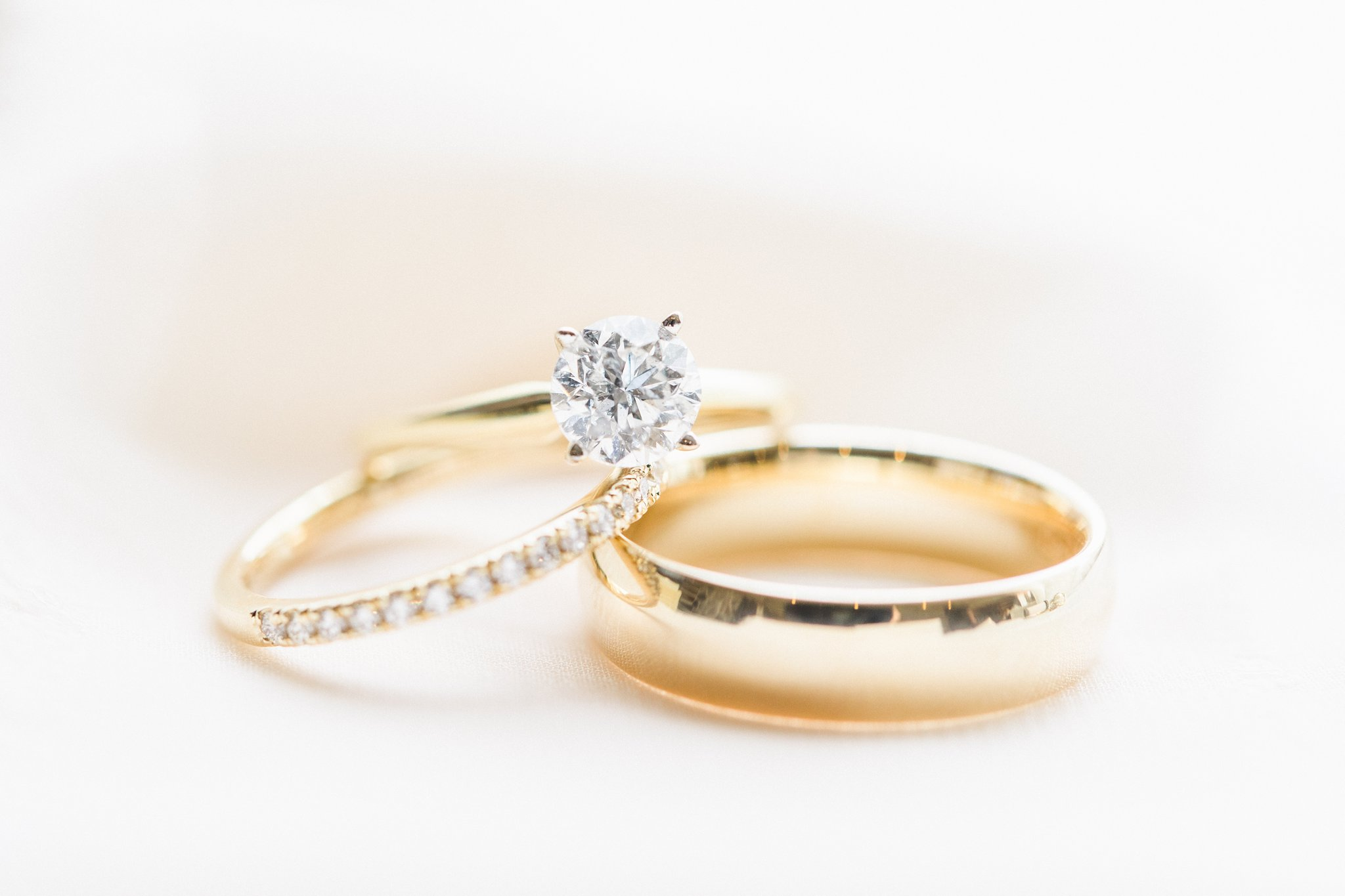 Yellow gold solitaire diamond ring with matching groom and bride wedding band married at Stonefields, Amy Pinder Photography