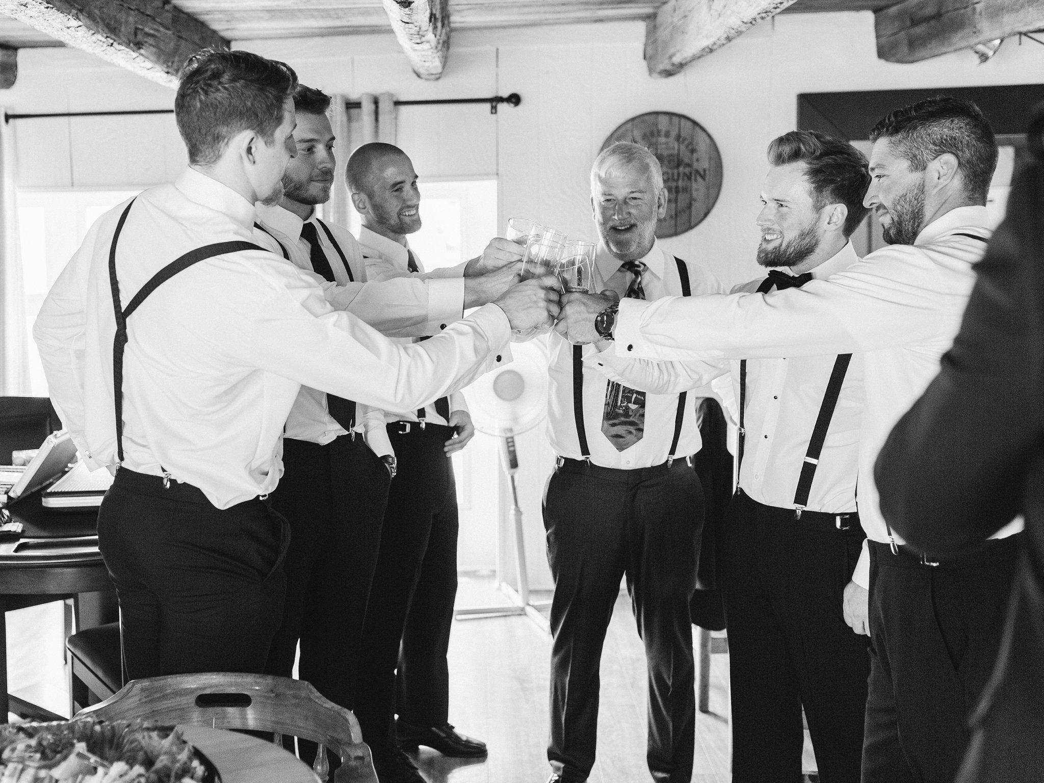 Groomsmen cheers at groom prep married at Stonefields, Amy Pinder Photography