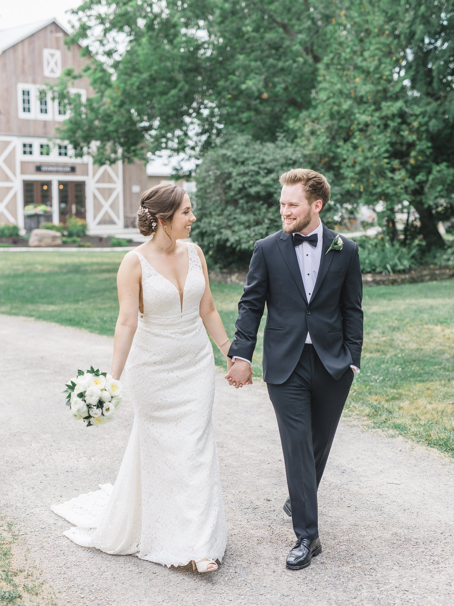 Plunging v-neck wedding dress with illusion sides married at Stonefields, Amy Pinder Photography