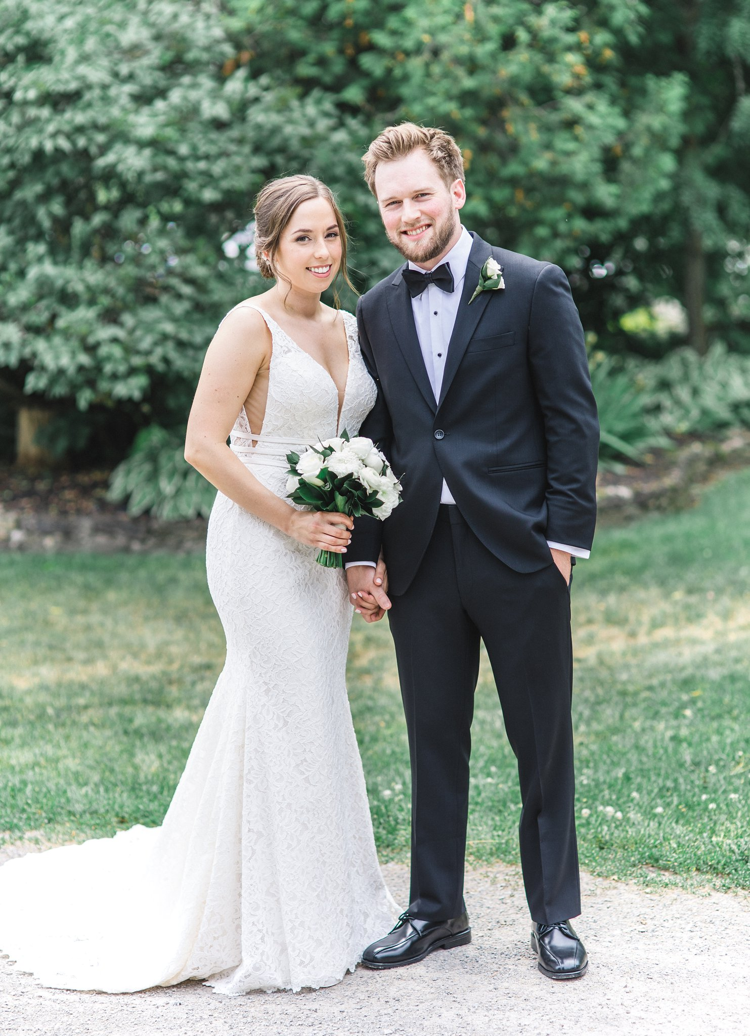 Classic black suite with bowtie with modern dress married at Stonefields, Amy Pinder Photography