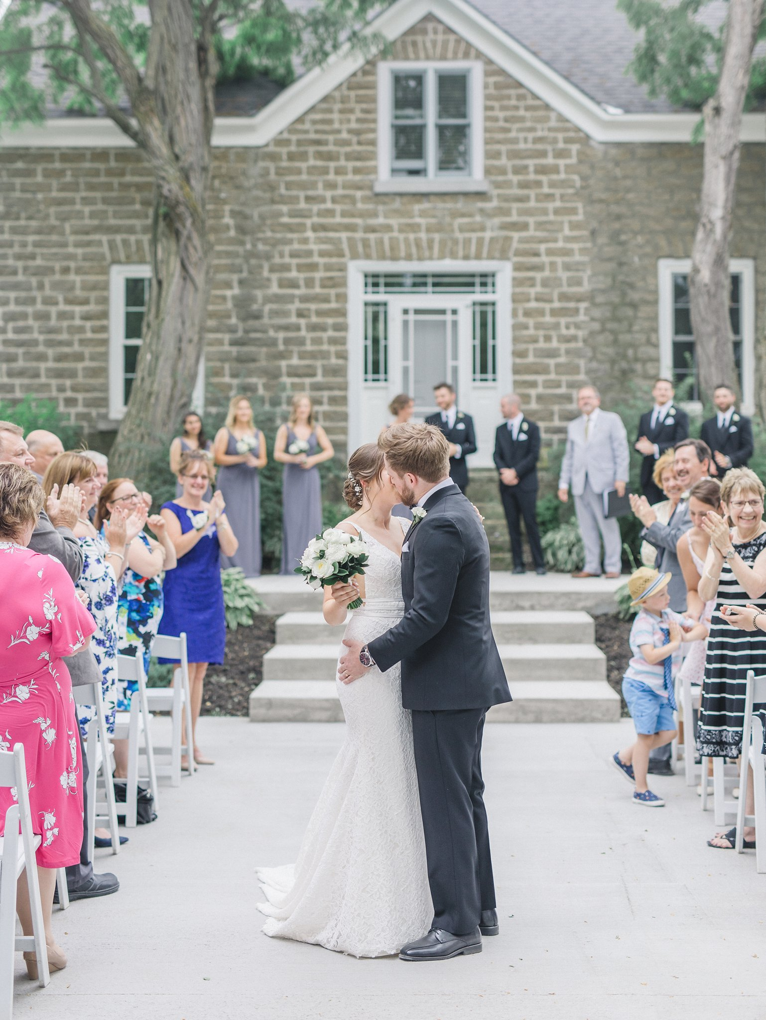 Kiss down the aisle married at Stonefields, Amy Pinder Photography