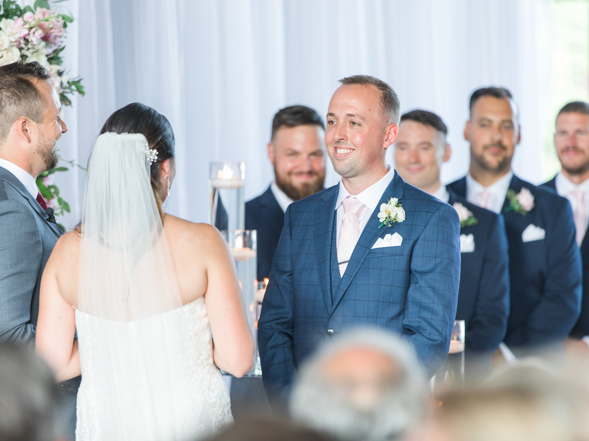 Groom's checkered blue suit at ceremony Horticulture Building wedding at Lansdowne Amy Pinder Photography