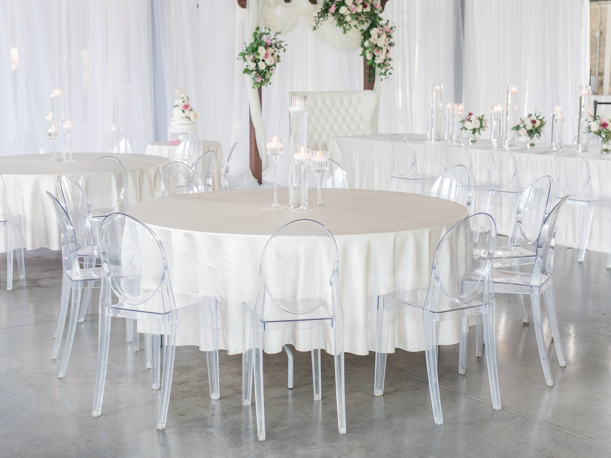 Round table with ghost chairs cream linen Horticulture Building wedding at Lansdowne Amy Pinder Photography