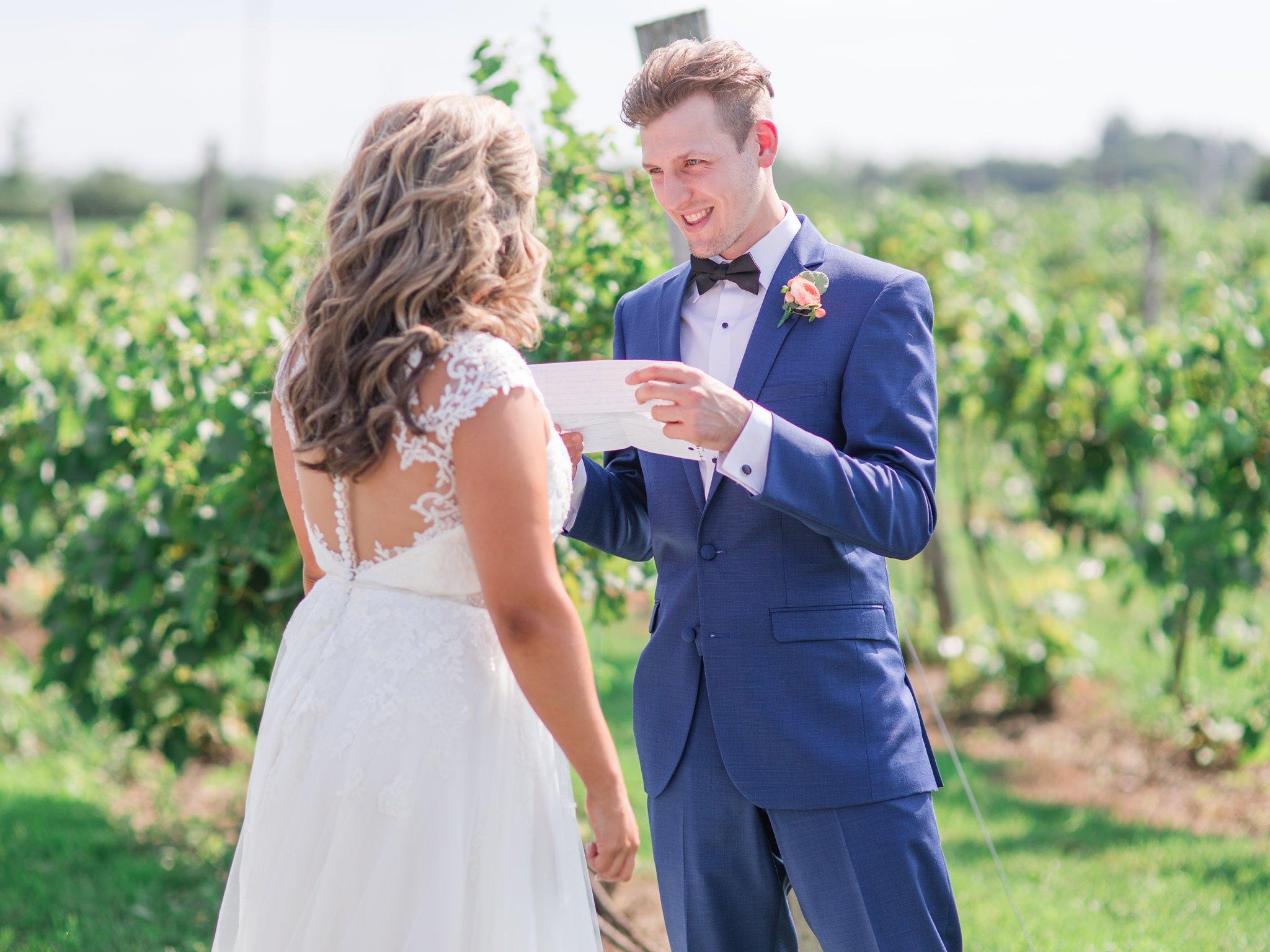 Reading vows at first look Vineyard wedding at Jabulani Amy Pinder Photography