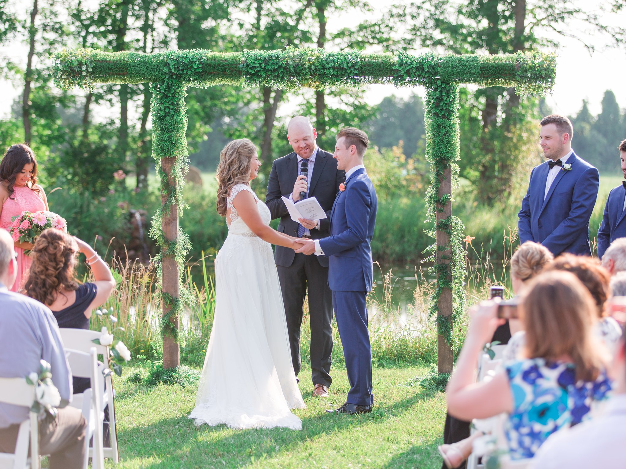 Arch covered in faux greenery Vineyard wedding at Jabulani Amy Pinder Photography