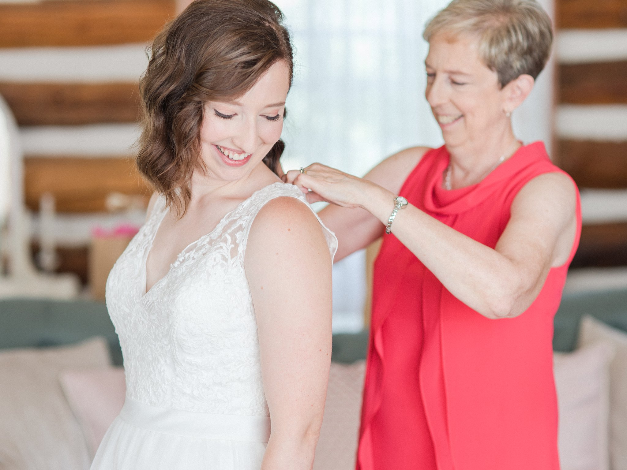 Mother buttoning bride's dress Dog-friendly wedding venue Ottawa Stonefields Amy Pinder Photography