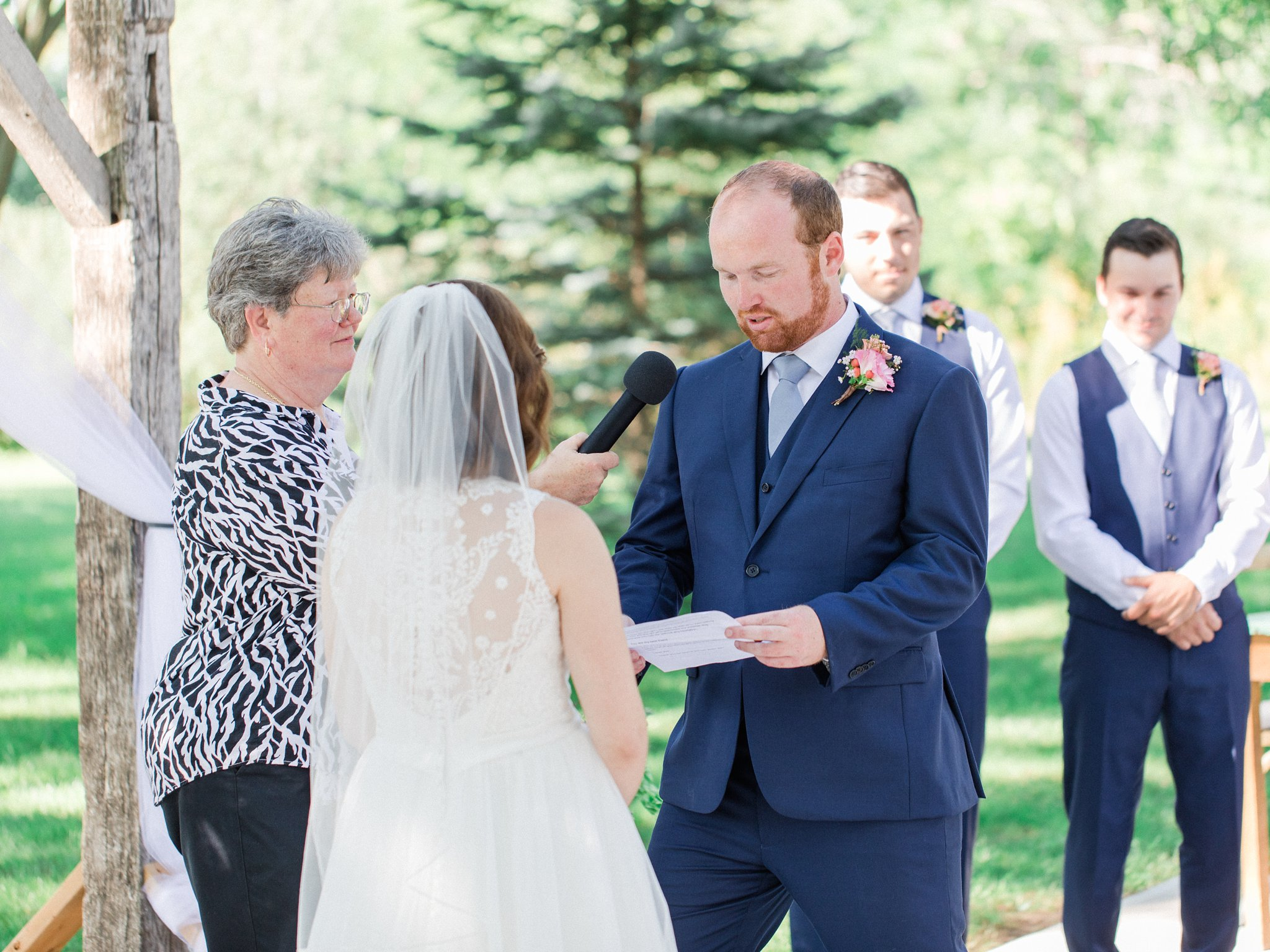 Groom reading vows Dog-friendly wedding venue Ottawa Stonefields Amy Pinder Photography
