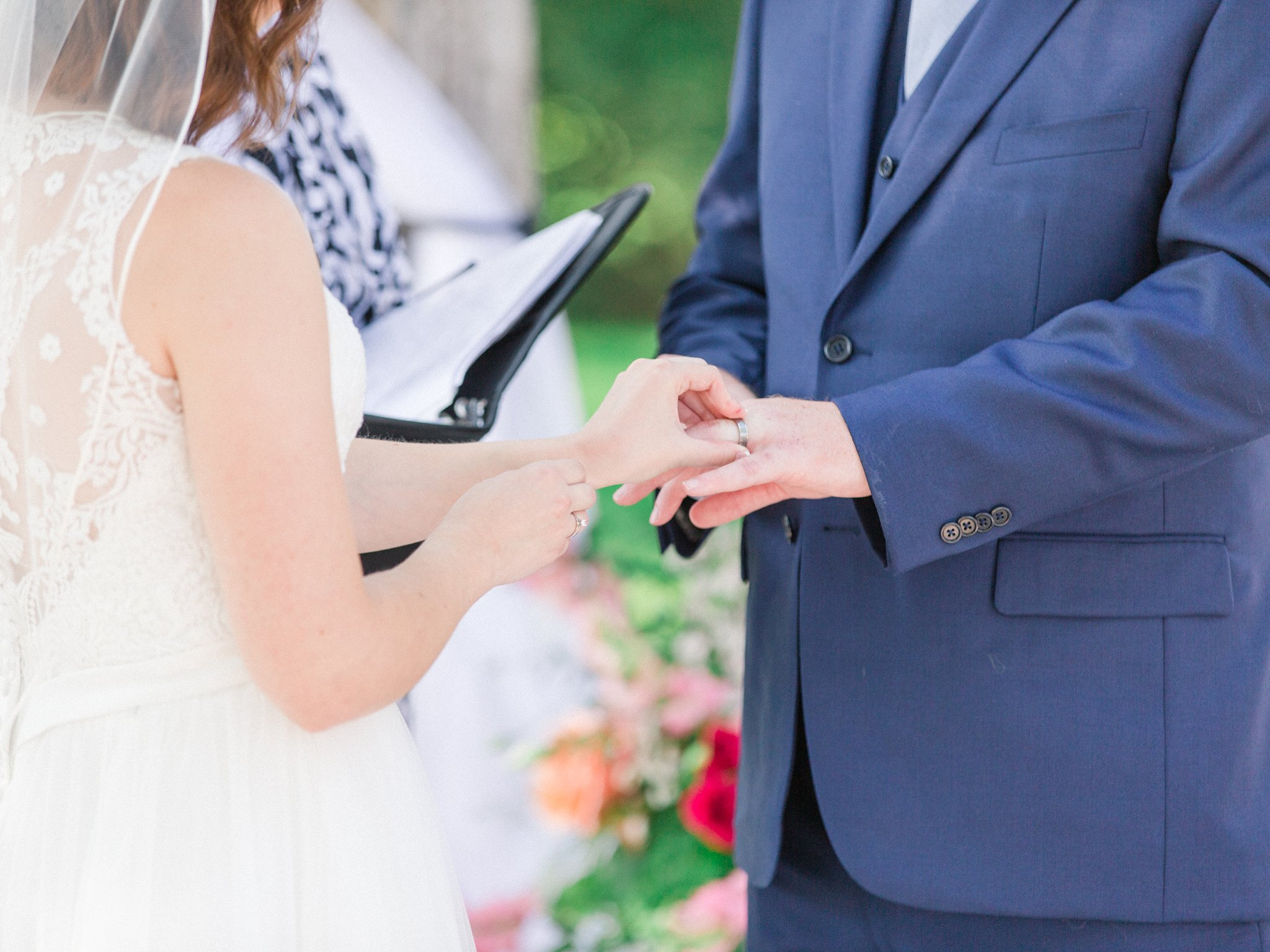 Exchanging rings Dog-friendly wedding venue Ottawa Stonefields Amy Pinder Photography