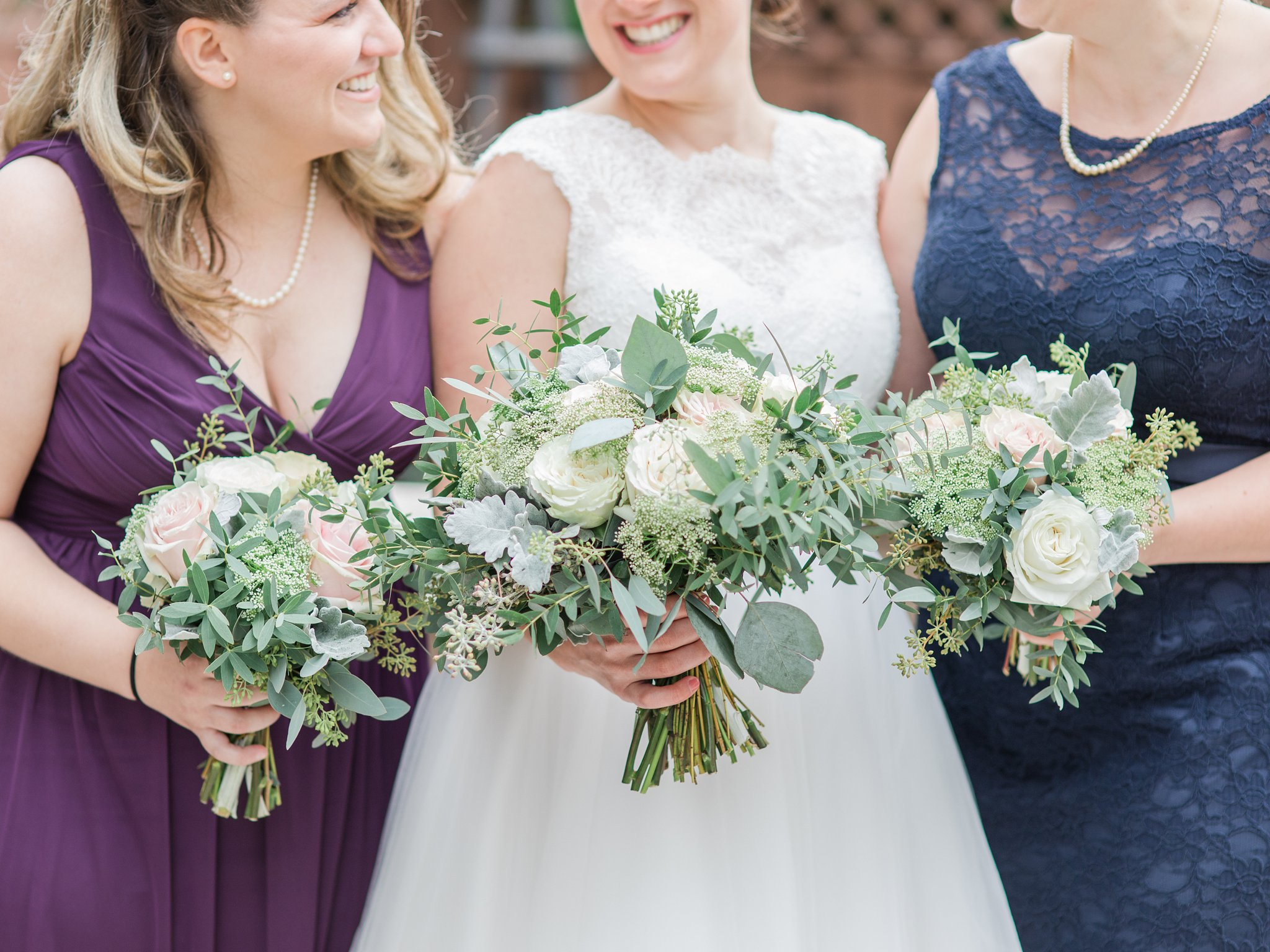 White bouquets with greenery Fall Wedding Photos Ottawa Mill Street Brew Pub