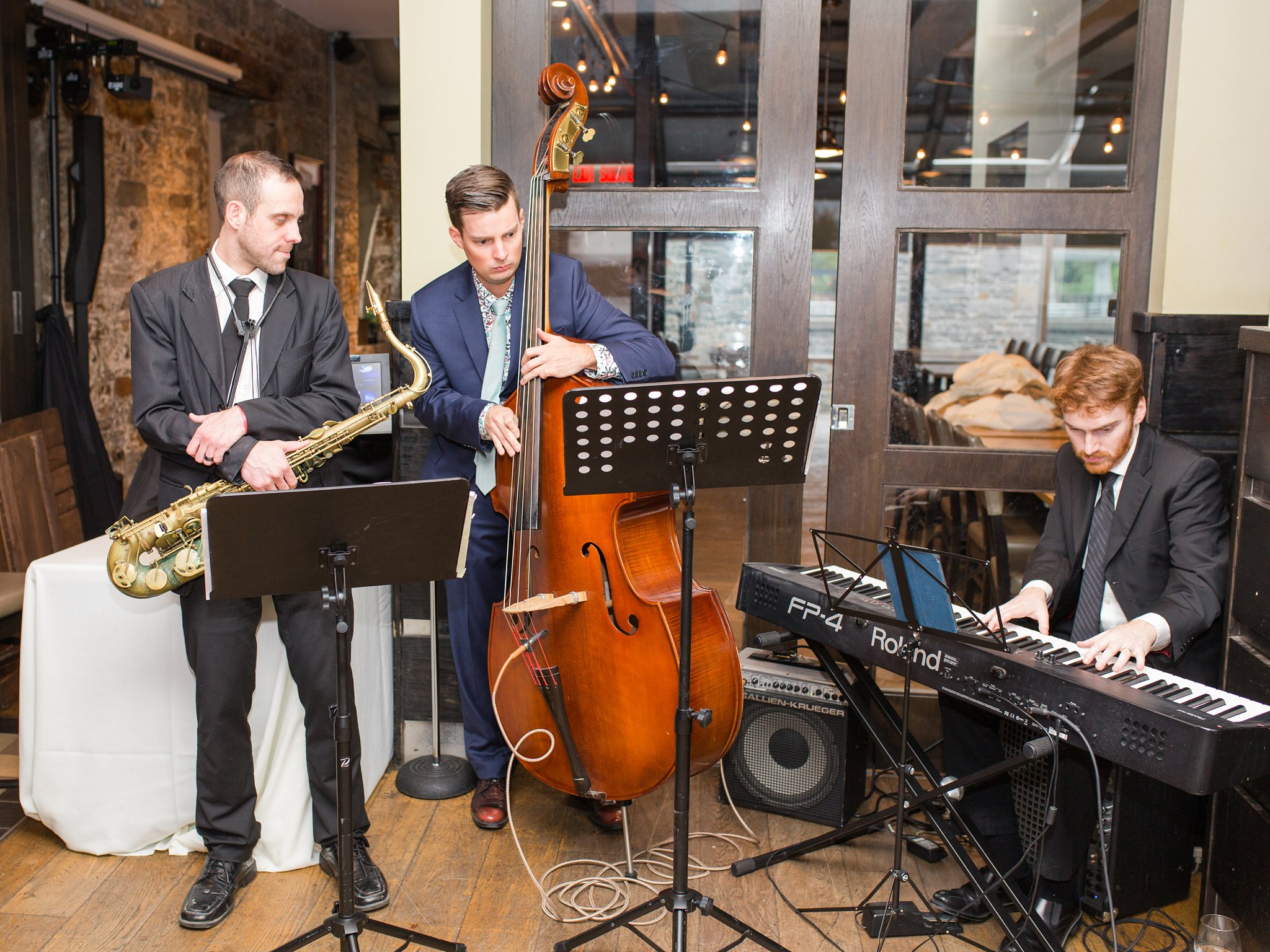 Live musicians during cocktail hour Fall Wedding Photos Ottawa Mill Street Brew Pub