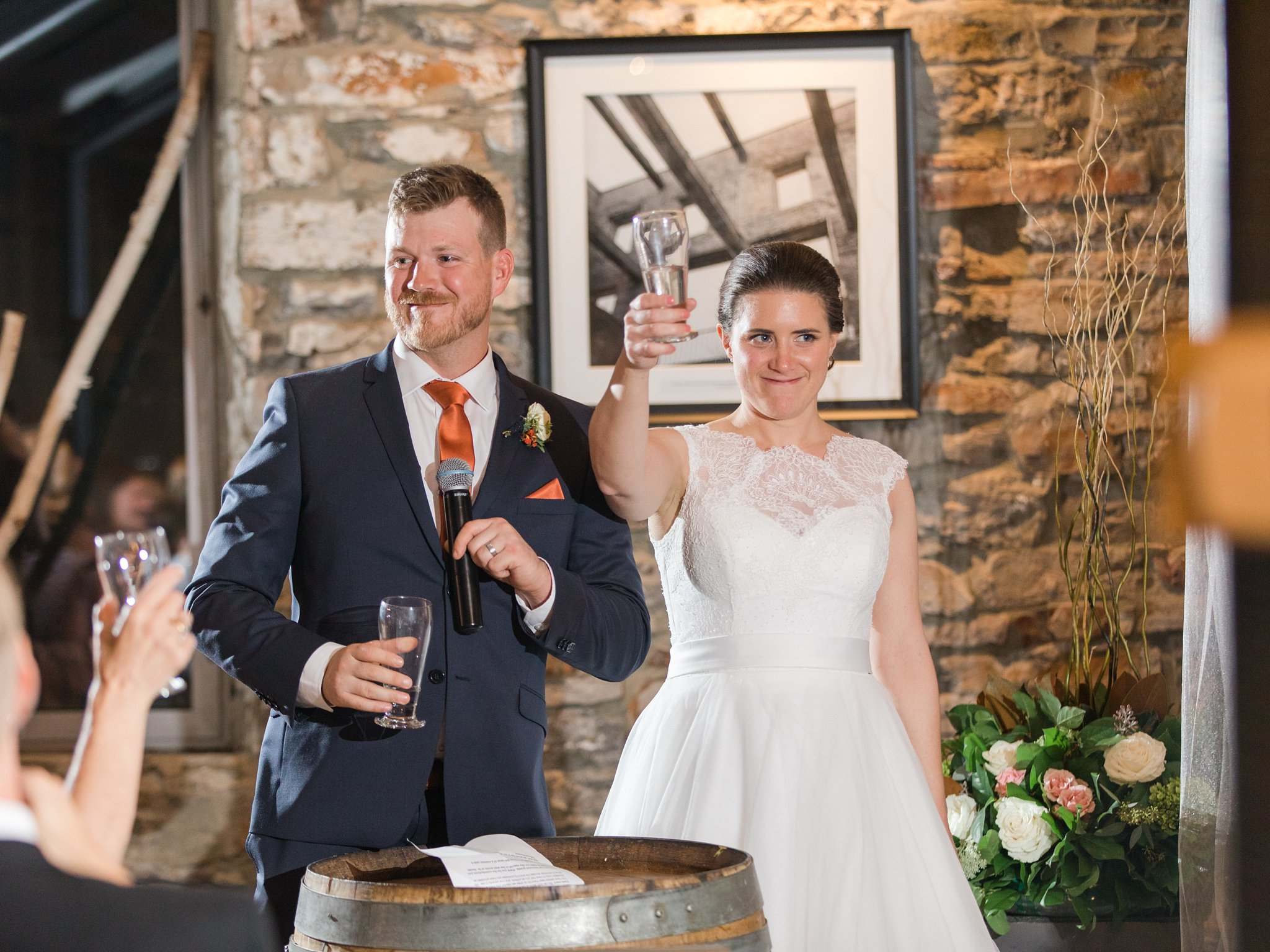 toast to the bride and groom Fall Wedding Photos Ottawa Mill Street Brew Pub