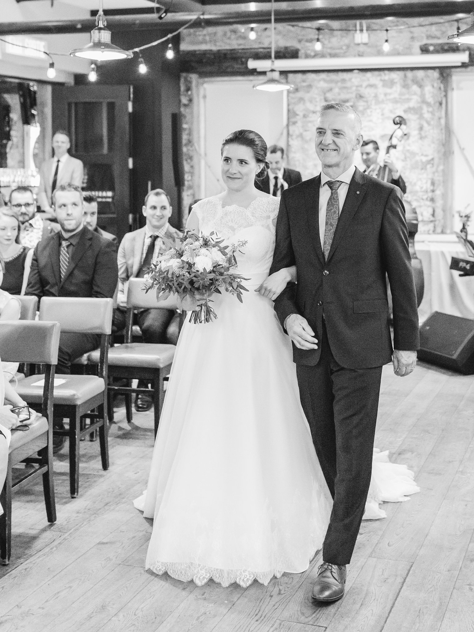 Bride and her father walk down the aisle Fall Wedding Photos Ottawa Mill Street Brew Pub