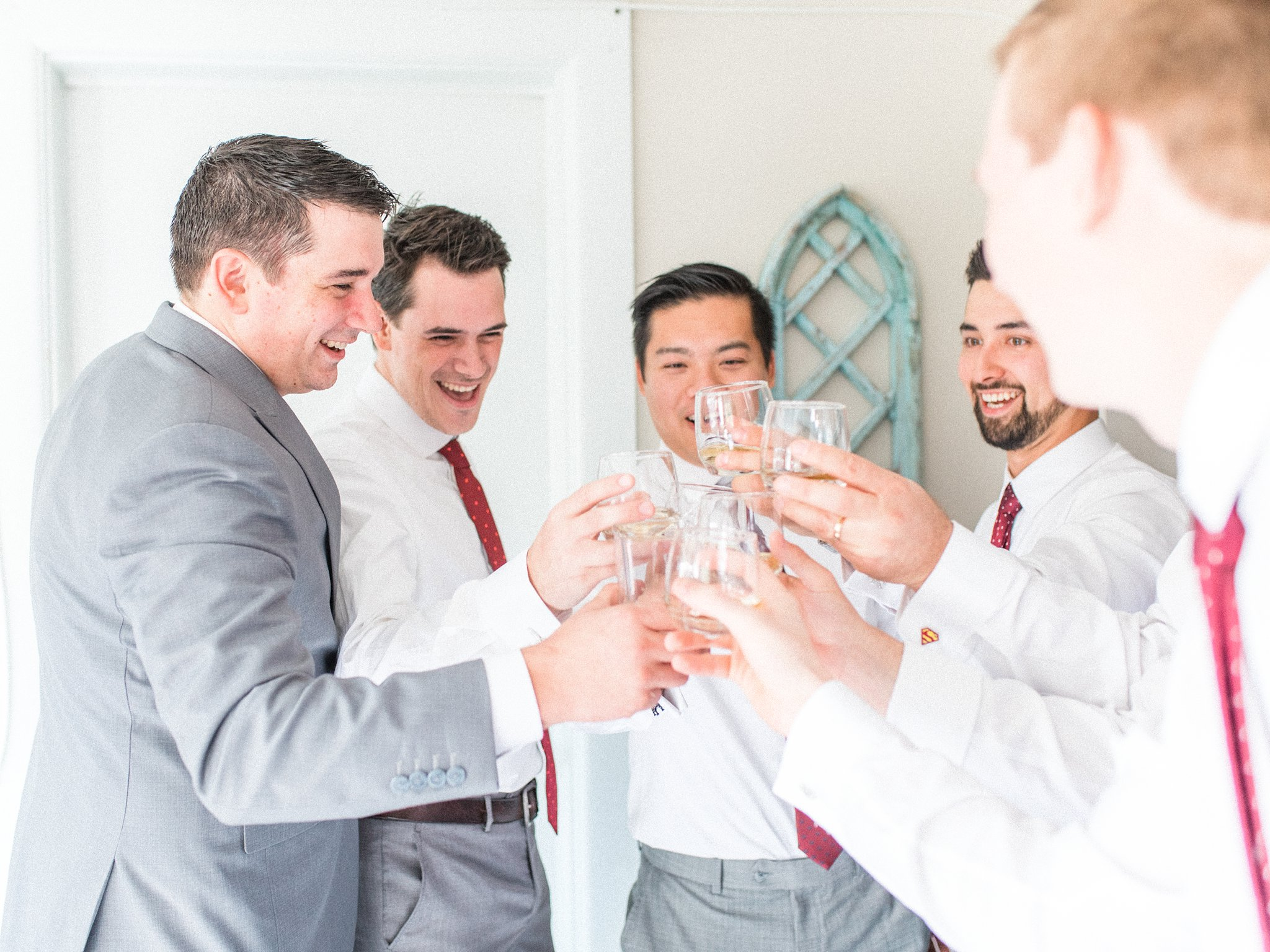 Cheers at groom prep Hilton Garden Inn Ottawa Airport Hotel Wedding