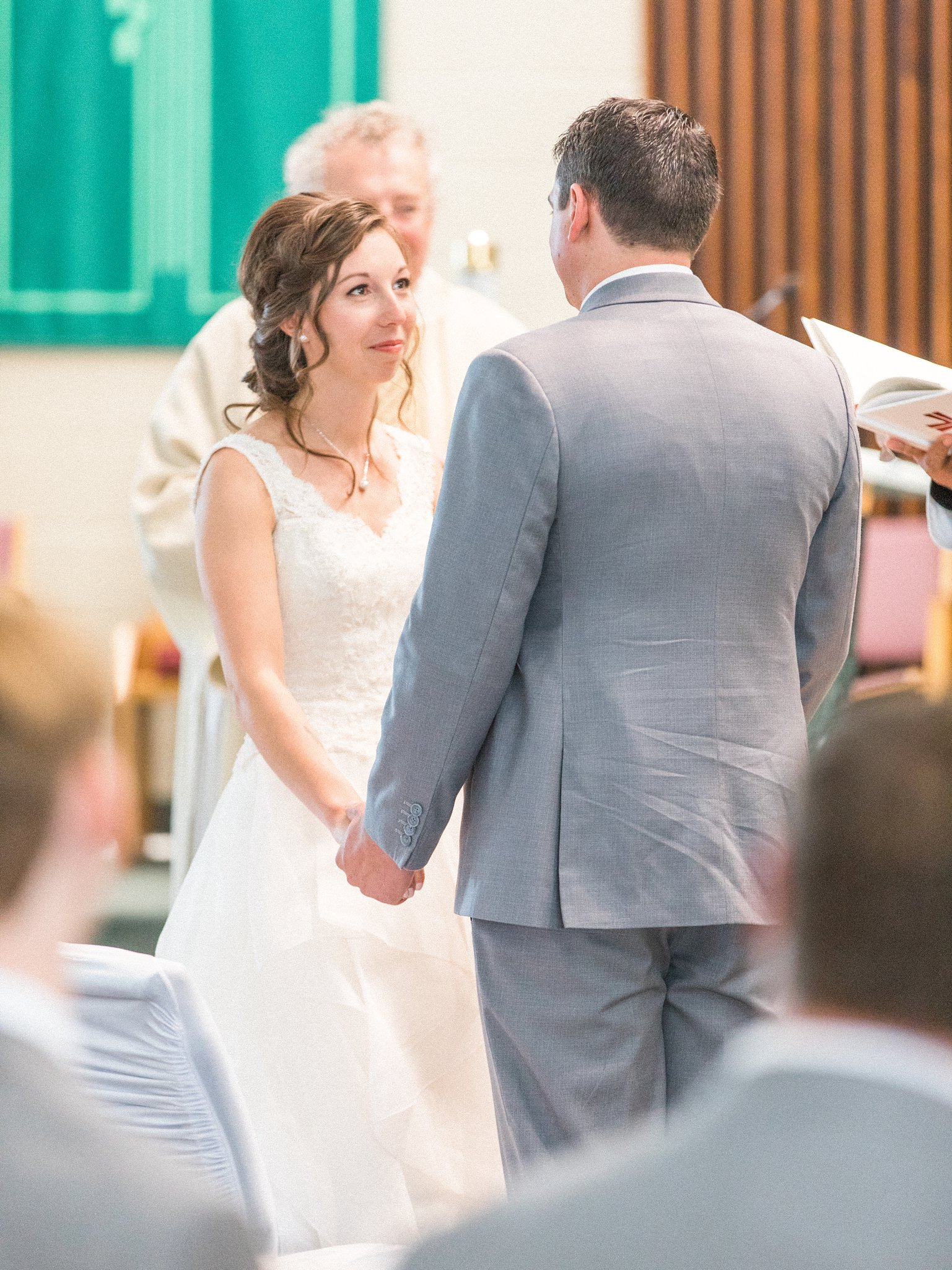Exchanging vows in a catholic ceremony Hilton Garden Inn Ottawa Airport Hotel Wedding