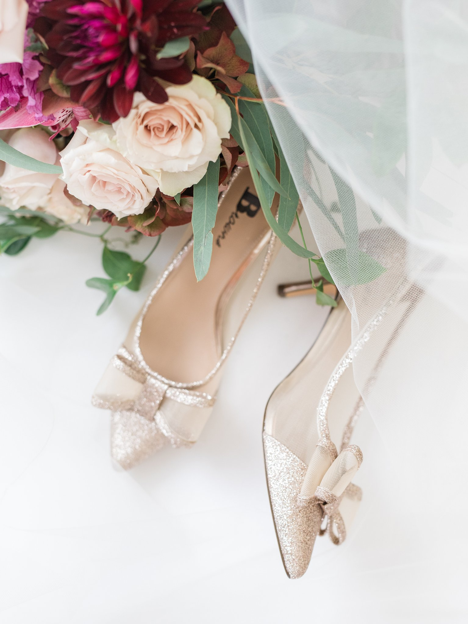 Gold wedding shoes with bow A Festive Fall Wedding at the Canadian Museum of Nature