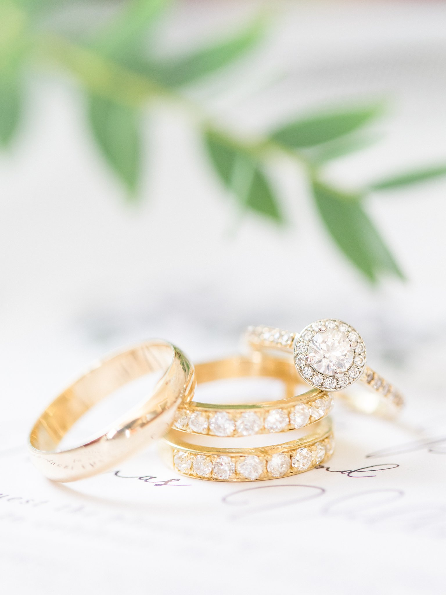 Yellow gold fused wedding bands with round halo diamond engagement ring A Festive Fall Wedding at the Canadian Museum of Nature