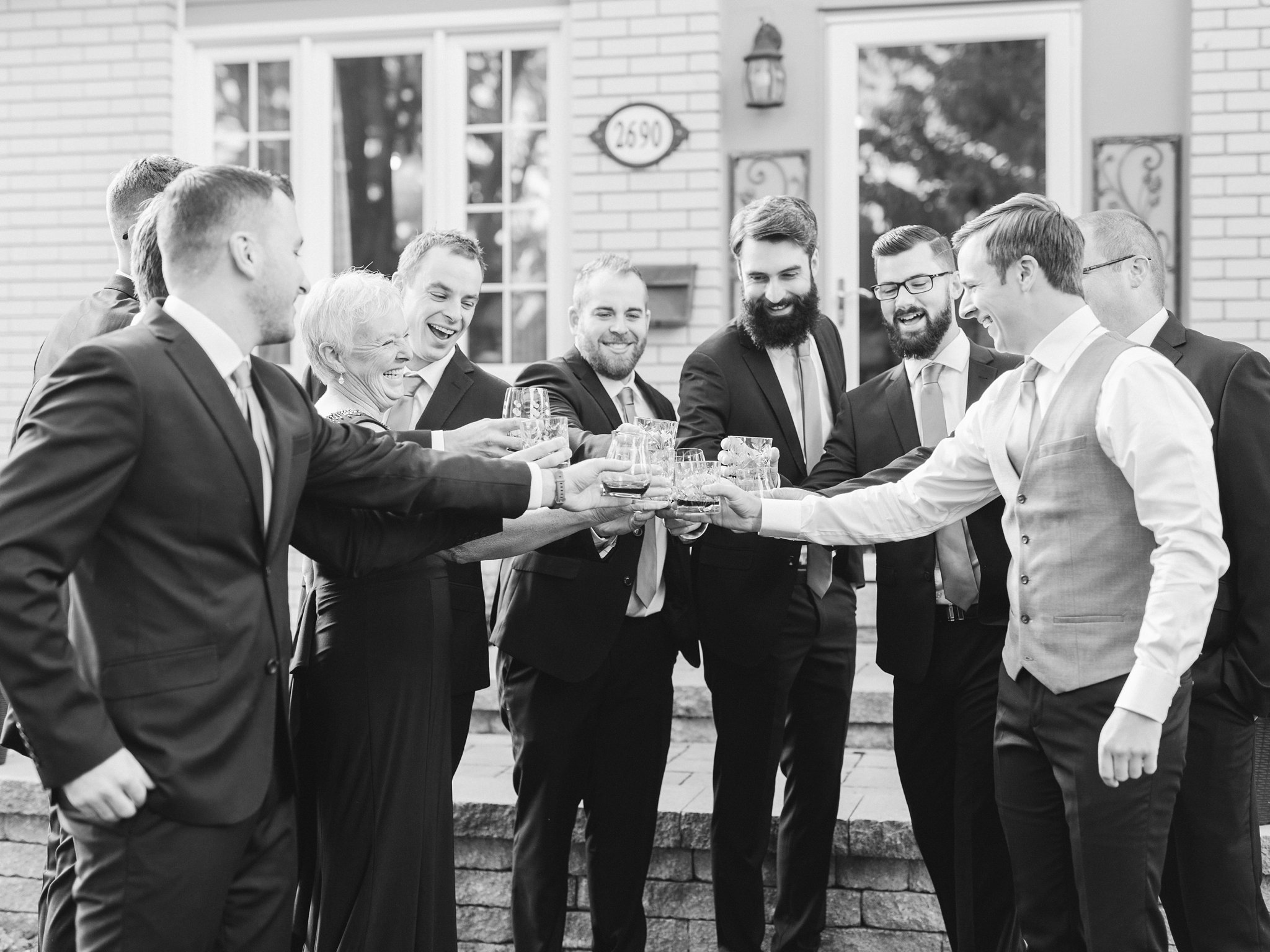 Cheers at groom prep A Festive Fall Wedding at the Canadian Museum of Nature