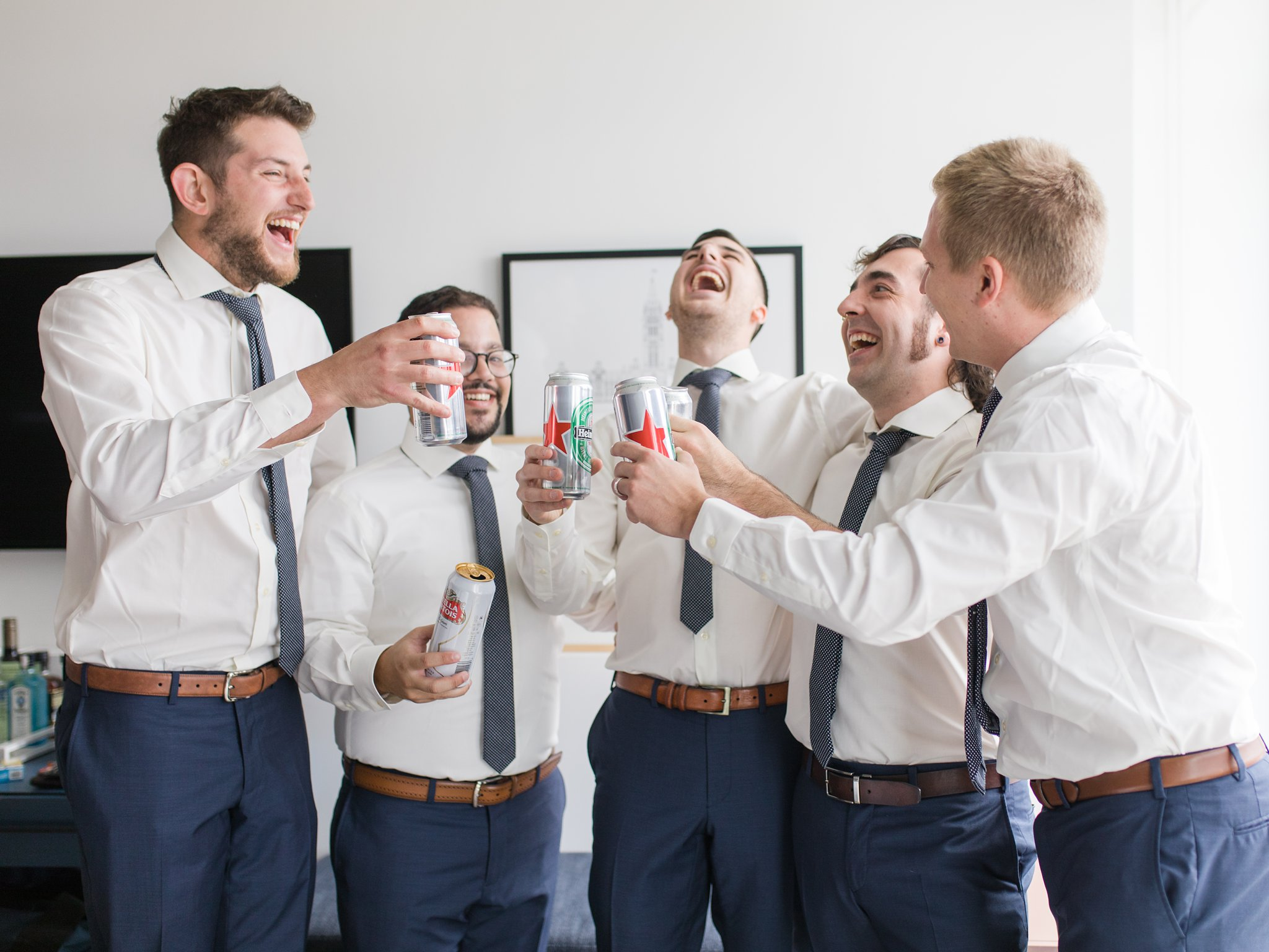 Cheers at groom prep Ottawa restaurant wedding at Sidedoor Restaurant