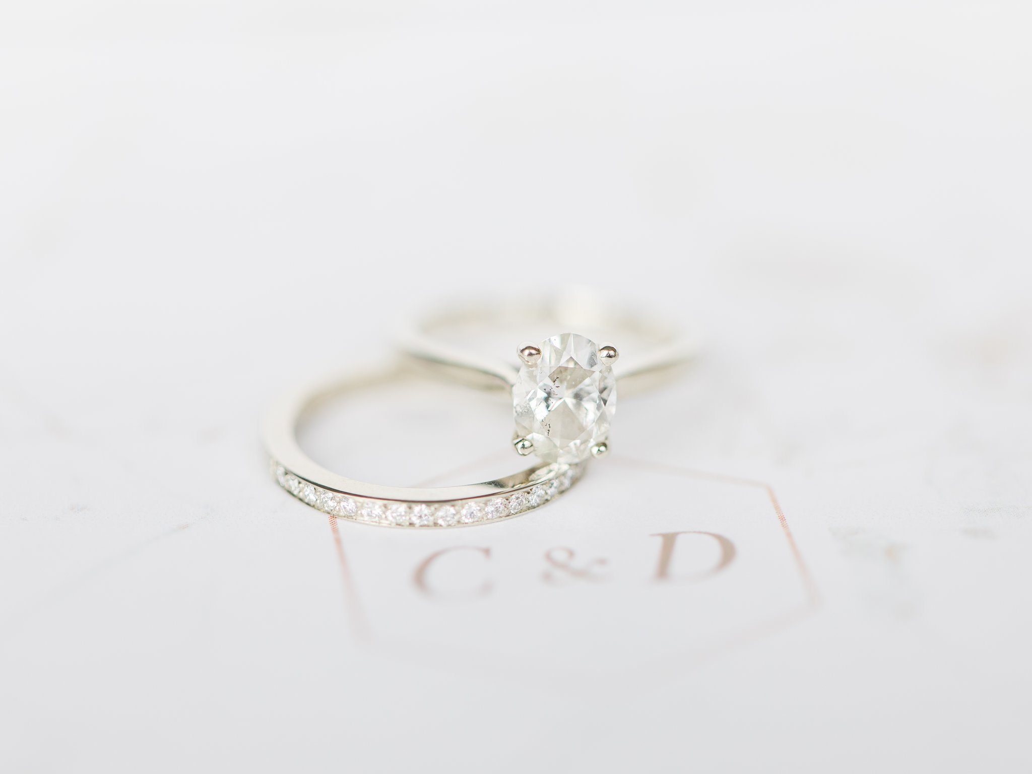 Oval engagement ring with classic wedding band Ottawa restaurant wedding at Sidedoor Restaurant