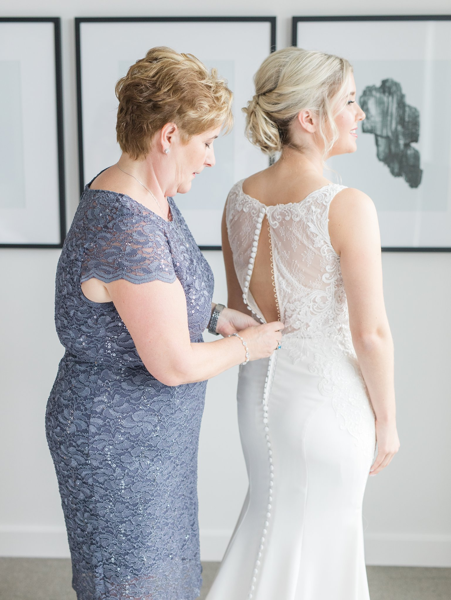Lace back dress with white satin buttons Ottawa restaurant wedding at Sidedoor Restaurant