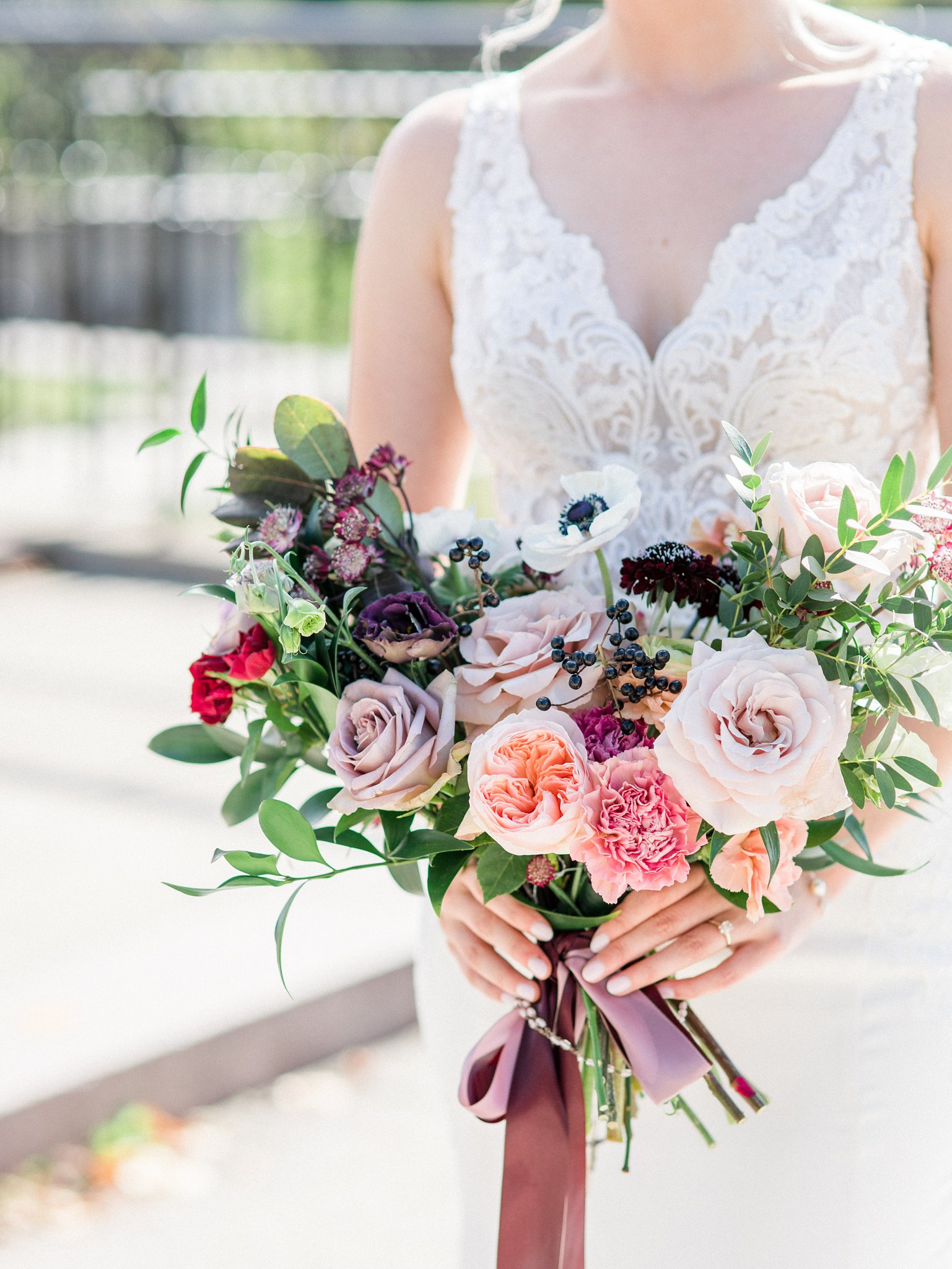 We are Frid bouquet with soft pink peach and purple roses Ottawa restaurant wedding at Sidedoor Restaurant