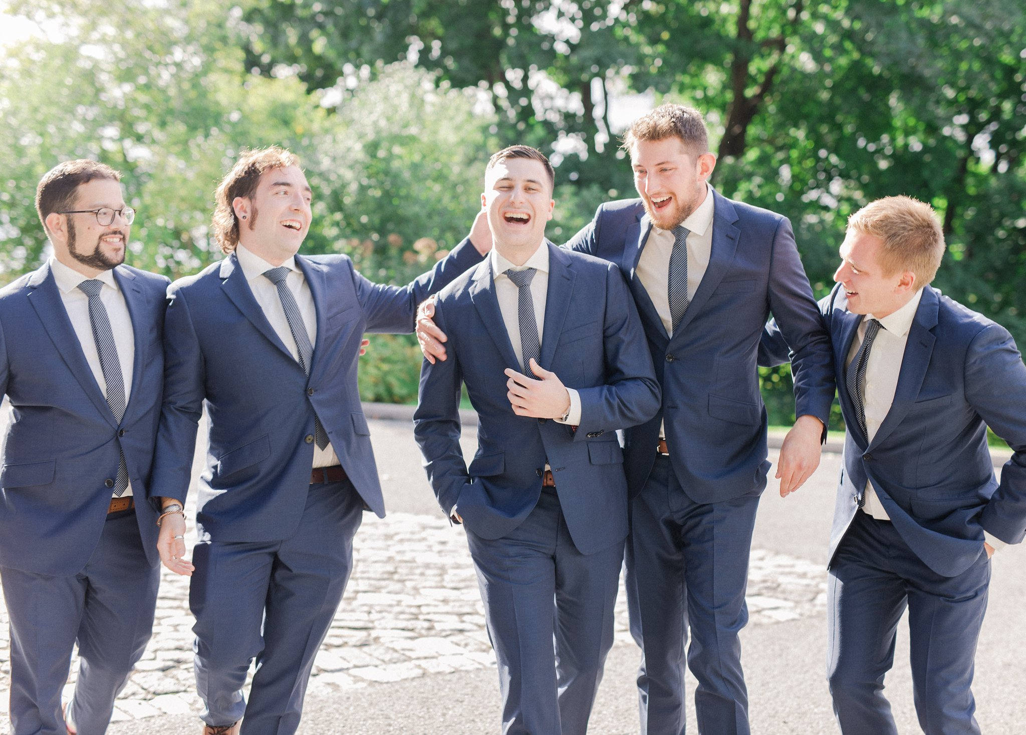 Groomsmen laughing at Major's Hill Park Ottawa restaurant wedding at Sidedoor Restaurant