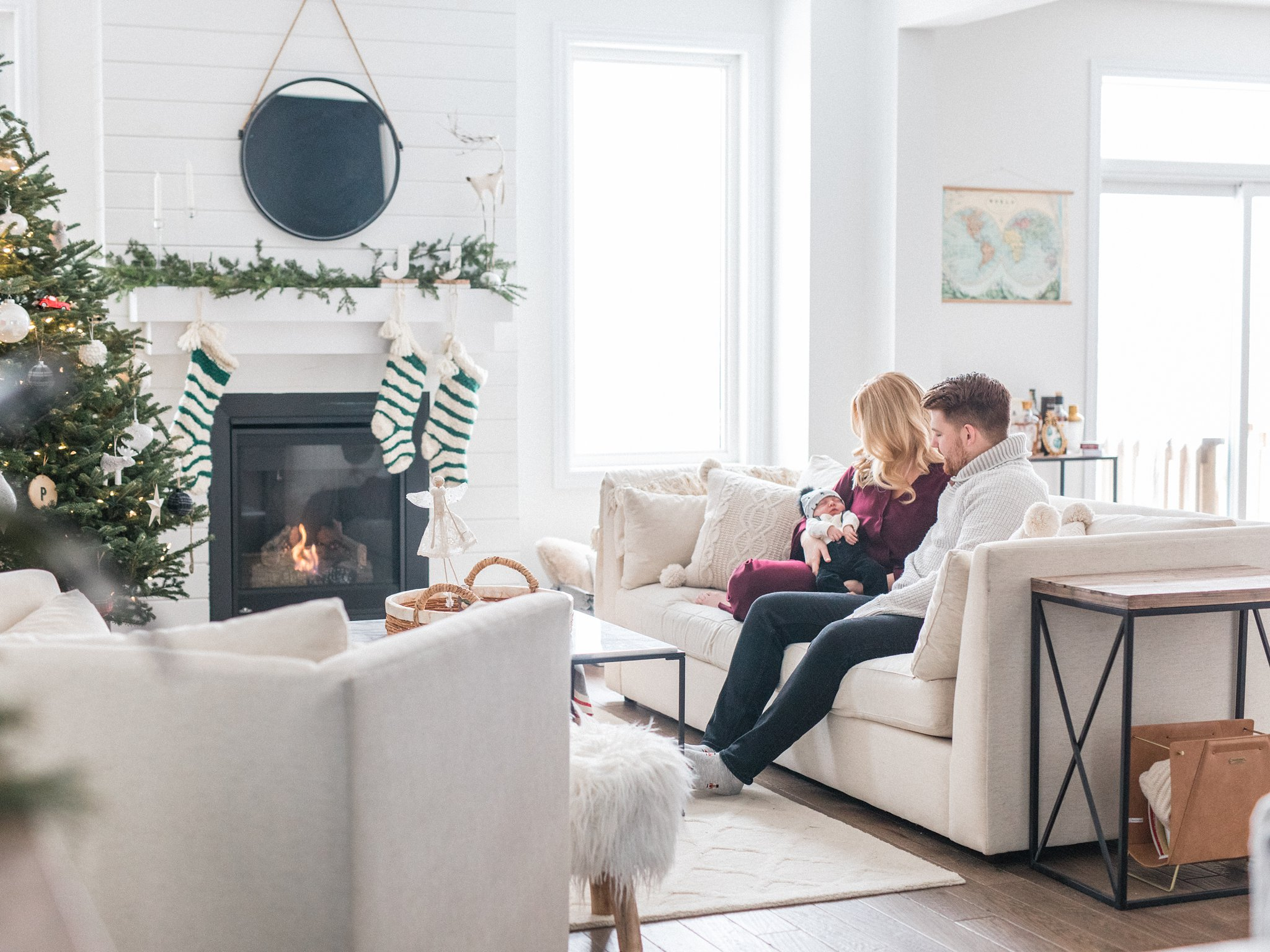 Modern living room, Festive Newborn Lifestyle Photos During the Christmas Holidays, minimalist decor, white living room, white Christmas decor